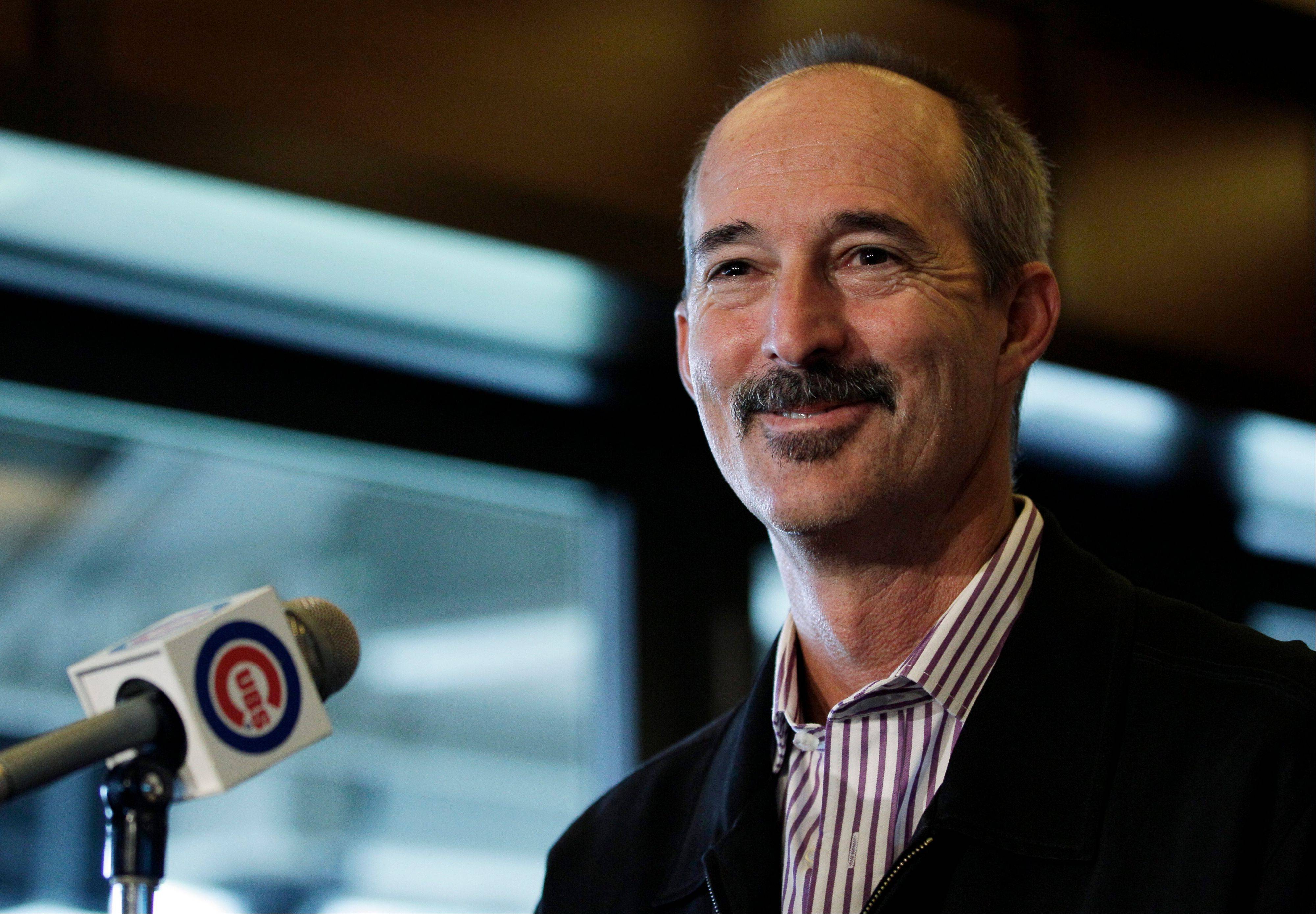 Texas Rangers pitching coach Mike Maddux smiles as he speaks at a news conference following his interview for the manager position with the Cubs at Wrigley Field.