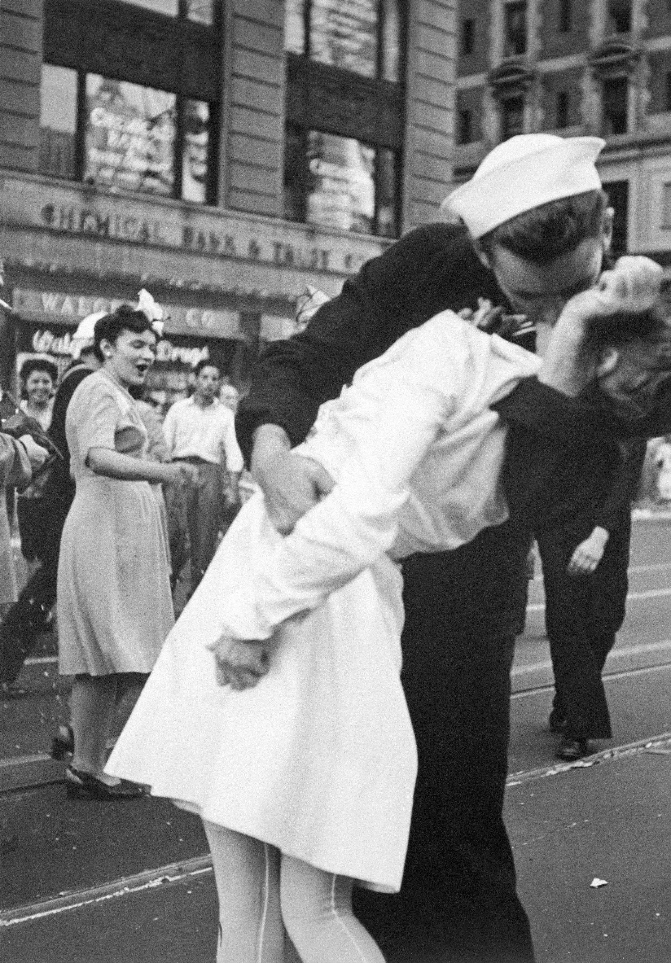 "A sailor and nurse celebrate the end of World War II with a kiss in one of the most famous snapshots taken of V-J Day in 1945. The image is part of the ""Memories of World War II"" AP photo exhibit at the Pritzker Military Library in Chicago."