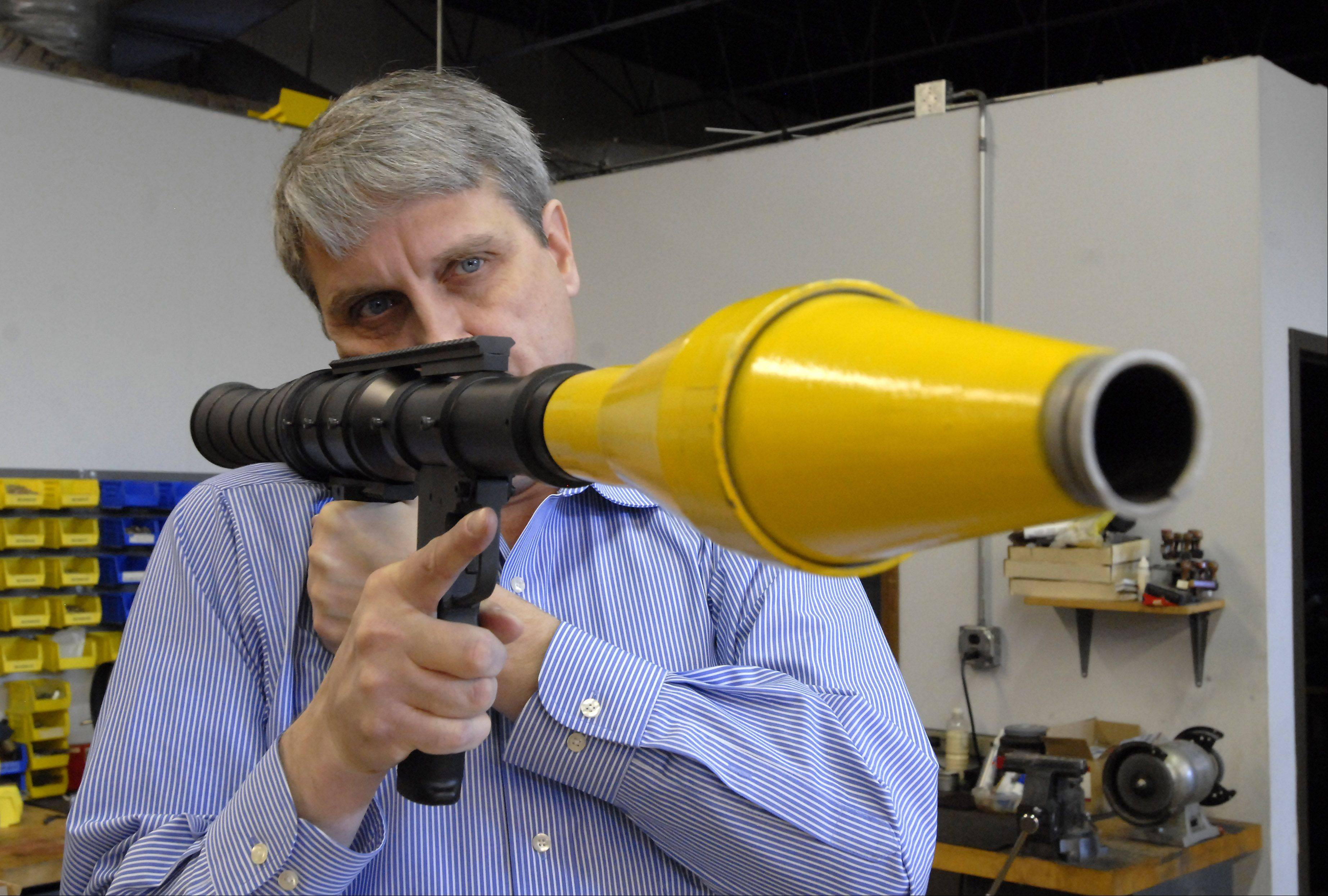 Bob Walter, president of Airtronic USA, holds an RPG7-USA rocket propelled grenade launcher that is manufactured in the Elk Grove Village facility.