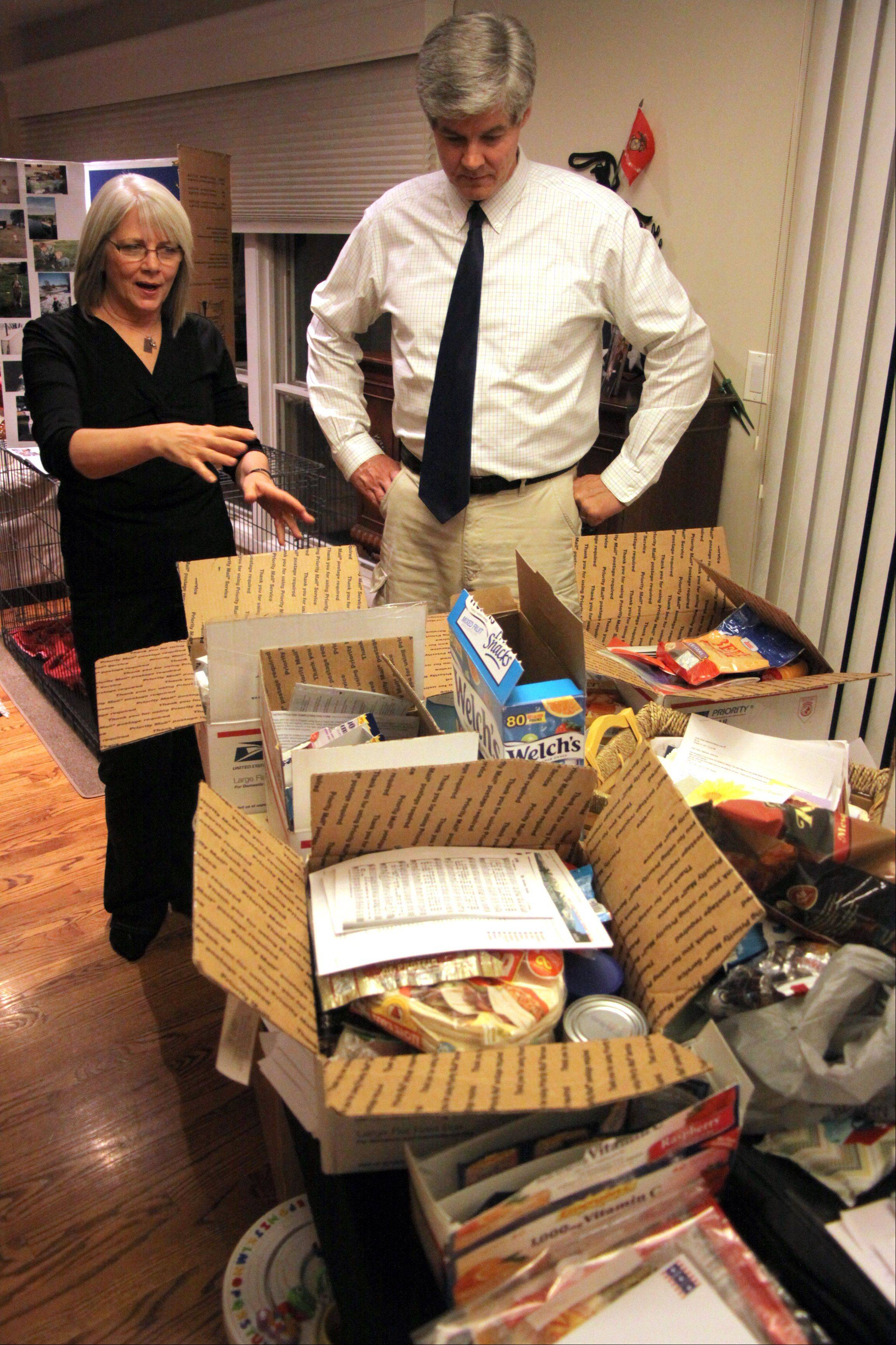 Robert and Linda Stack speak in their Arlington Heights home about care packages they are preparing for troops in Afghanistan. The Stacks lost their son, Marine Lance Cpl. James Stack, in the war in Afghanistan on Nov. 10, 2010.