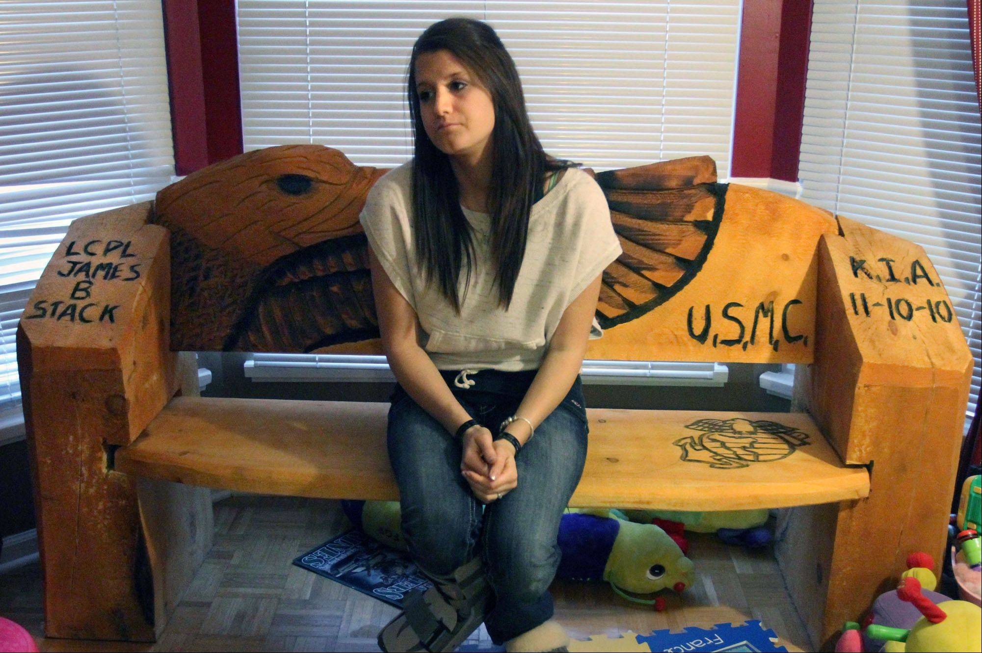 Katie Stack sits on a bench at her home in Palatine that she had made in honor of her husband, Marine Lance Cpl. James B. Stack, who died a year ago in Afghanistan's Helmand Province.