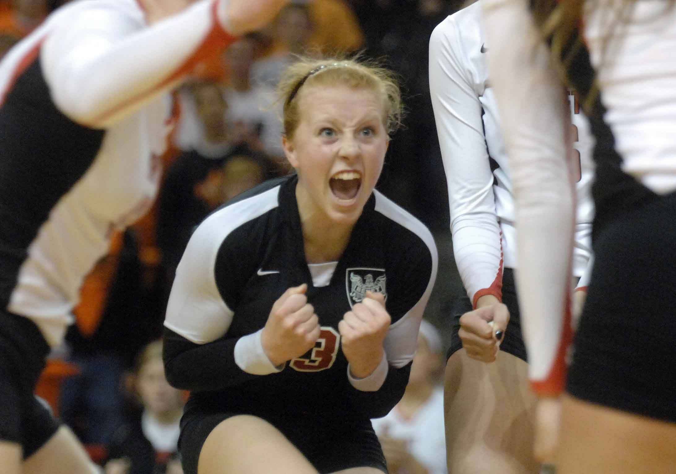 Sheila Doyle of Benet lets out a yell during the Benet vs. St. Charles East girls volleyball 4A semifinal Friday in Normal.