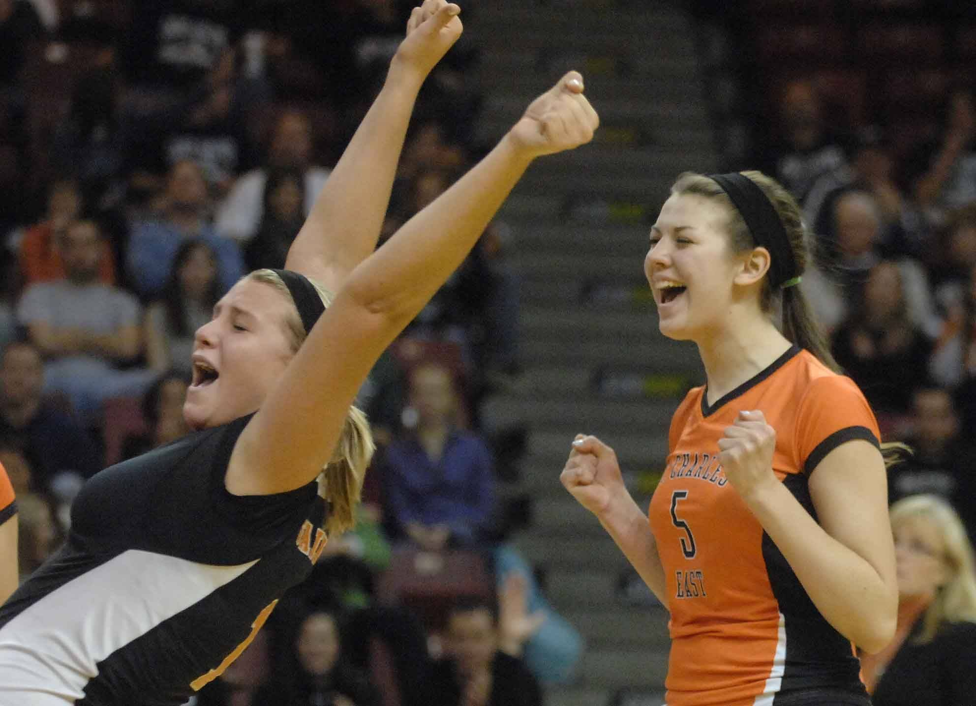 Maisey Mulvey,left, and Nicole Woods of St. Charles East let out a scream during the Benet vs. St. Charles East girls volleyball 4A semifinal Friday in Normal.