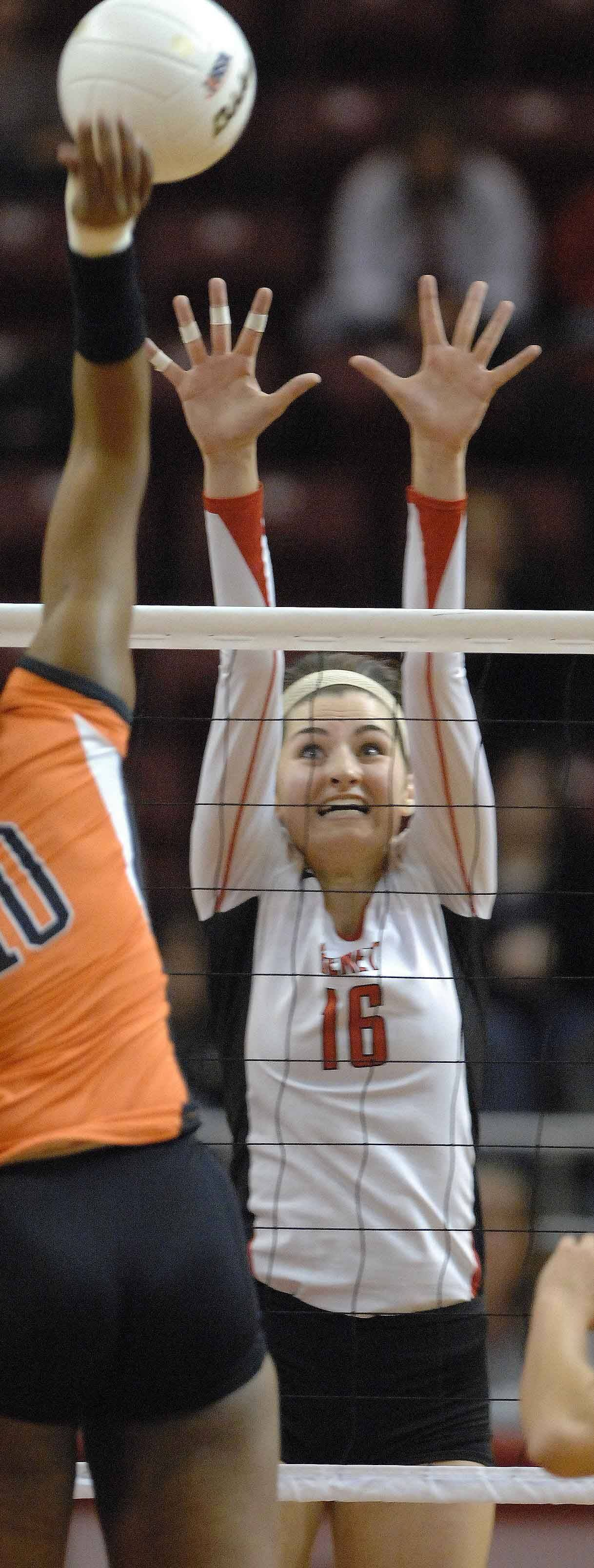 Nora Young of Benet block one during the Benet vs. St. Charles East girls volleyball 4A semifinal Friday in Normal.