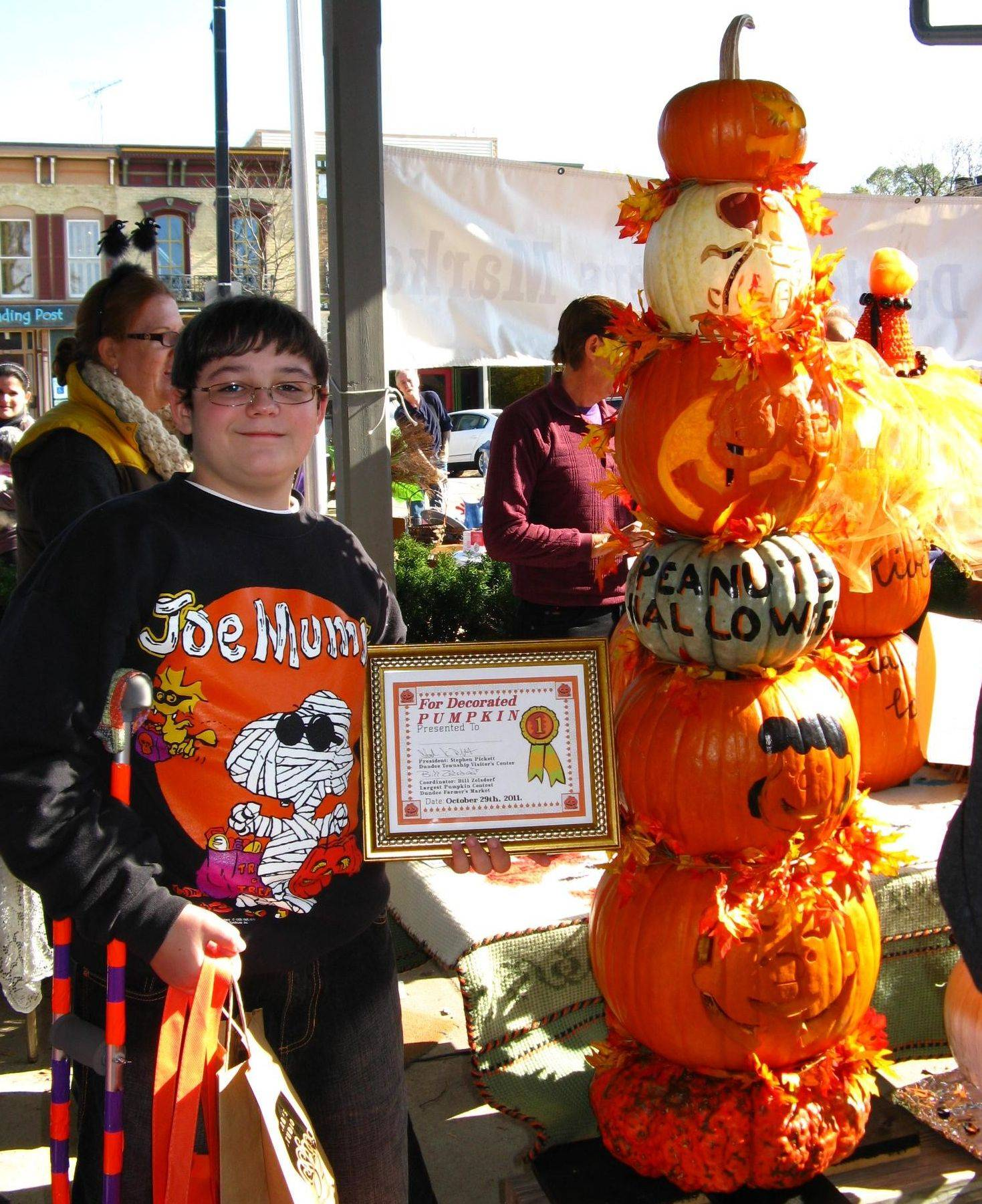 First-place winner in the 13th annual Great Pumpkin Contest hosted by the Dundee Township Visitor's Center went to Ryan Saxon, 13, of Cary for his Peanuts Pumpkin Tower.