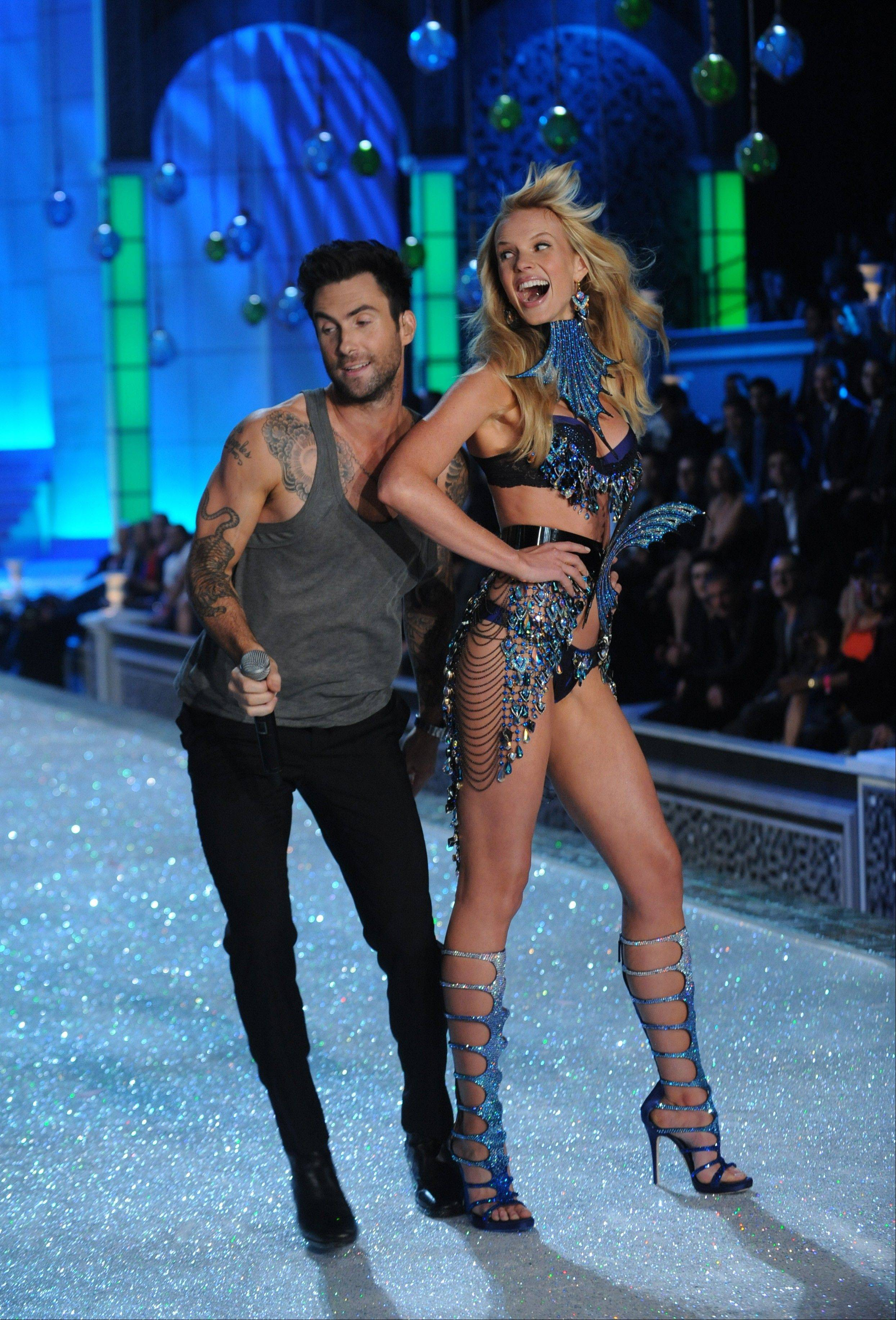 Adam Levine performs with a model during the Victoria's Secret fashion show in New York, Wednesday.