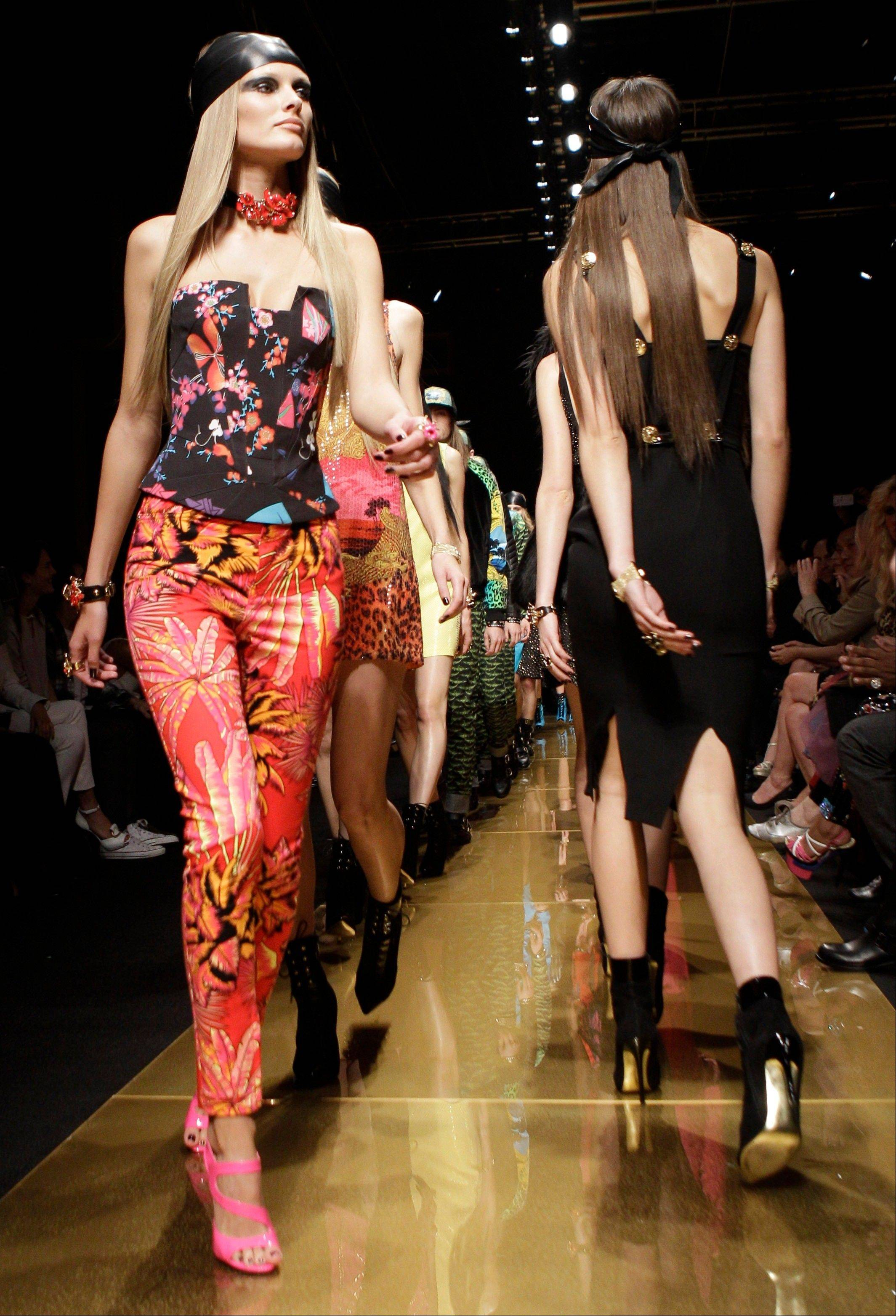 Models parade on the runway during the Versace for H&M fashion show in New York.