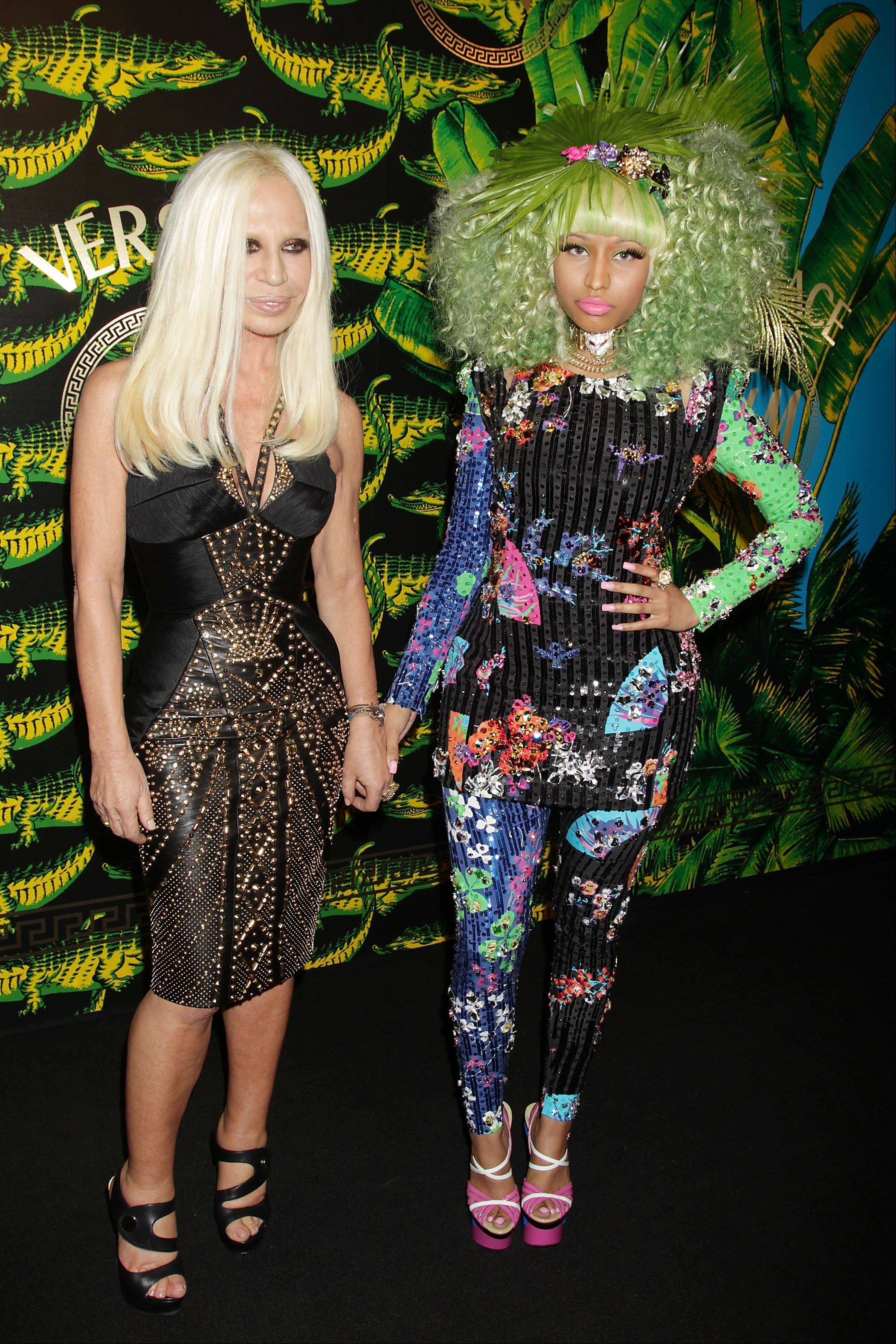 Designer Donatella Versace, left, and singer Nicki Minaj pose at the Versace for H&M Fashion Show and Party at Pier 57.