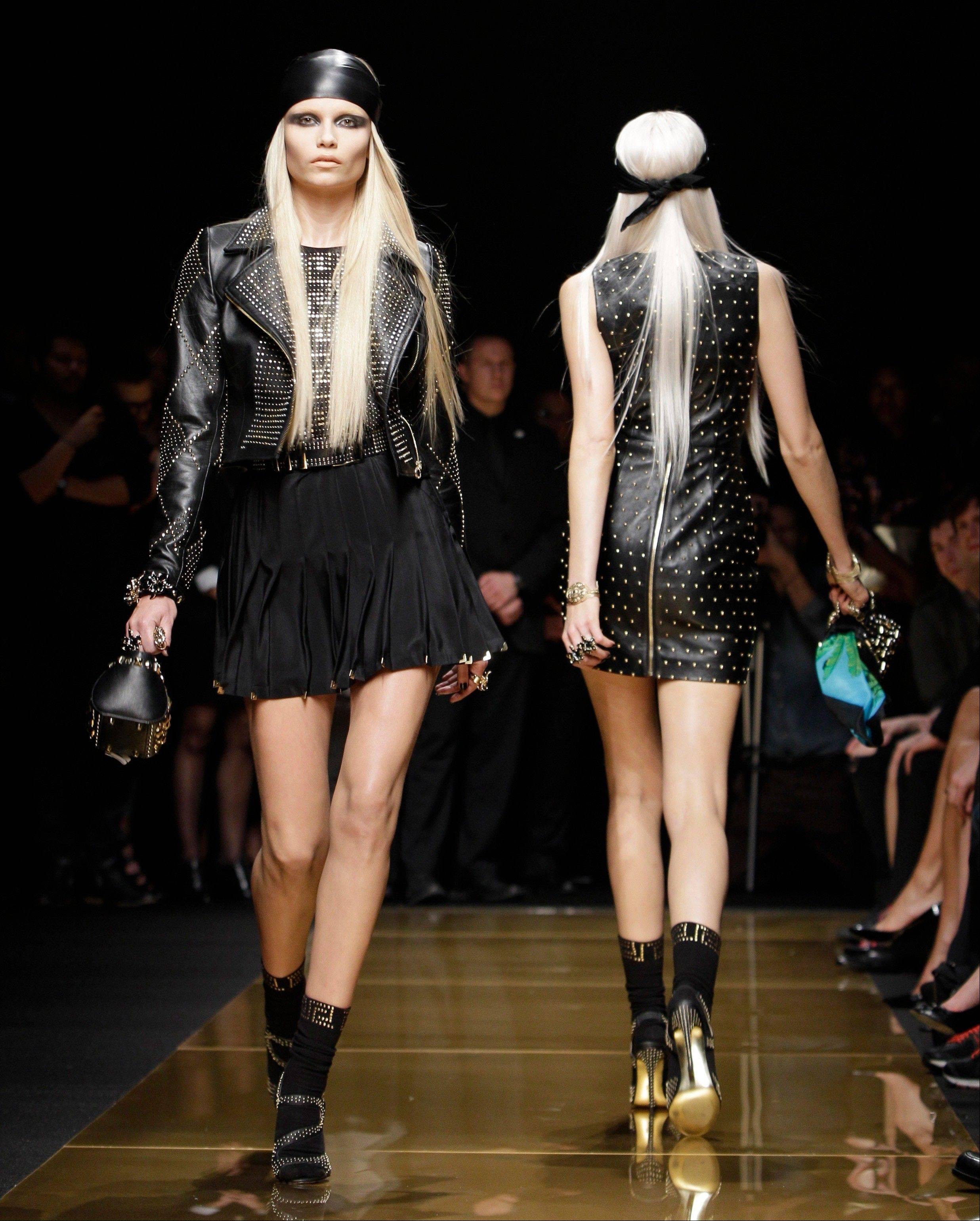 Models walk the runway during the Versace for H&M fashion show in New York.