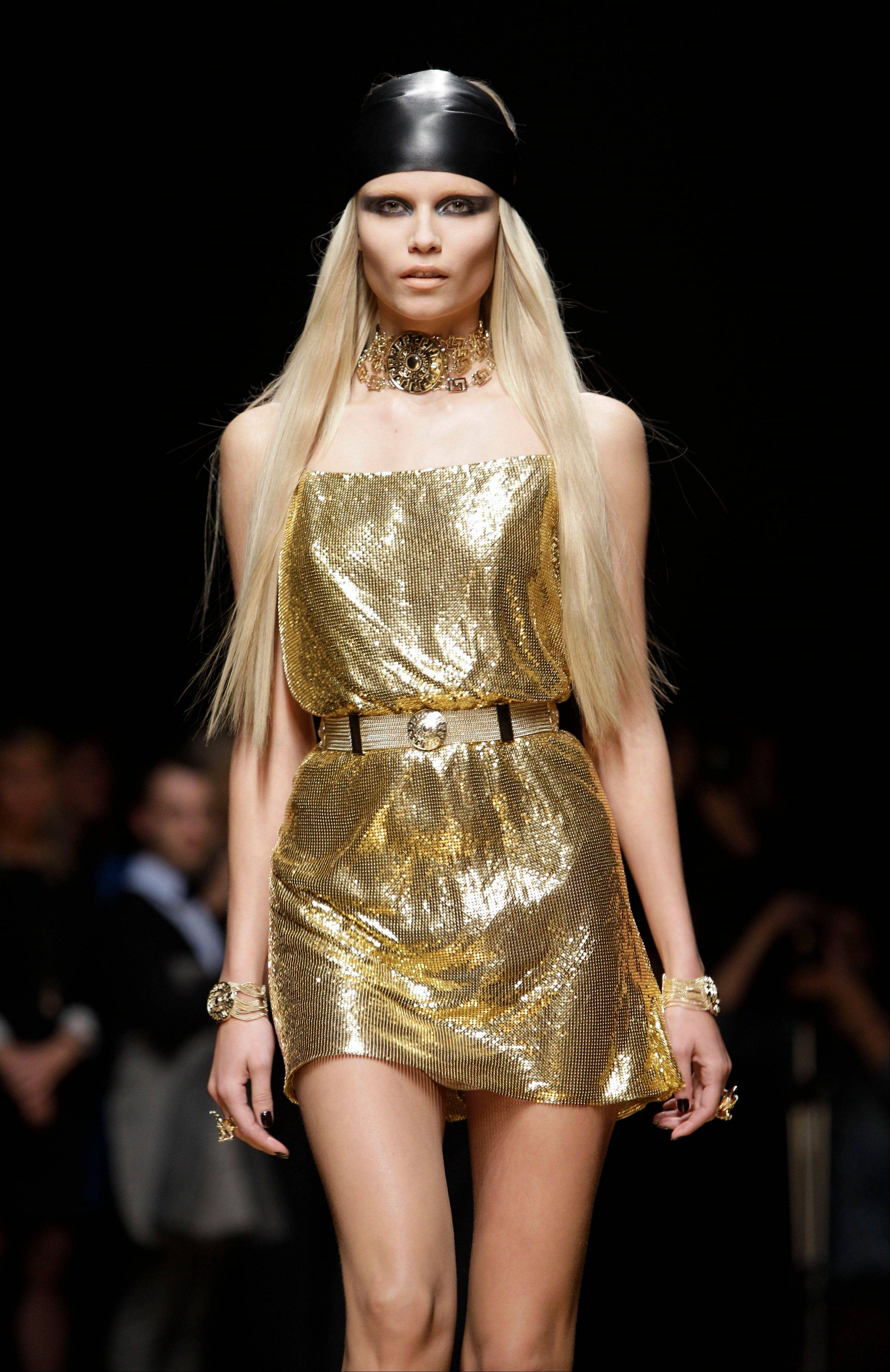 A model walks the runway during the Versace for H&M fashion show in New York.
