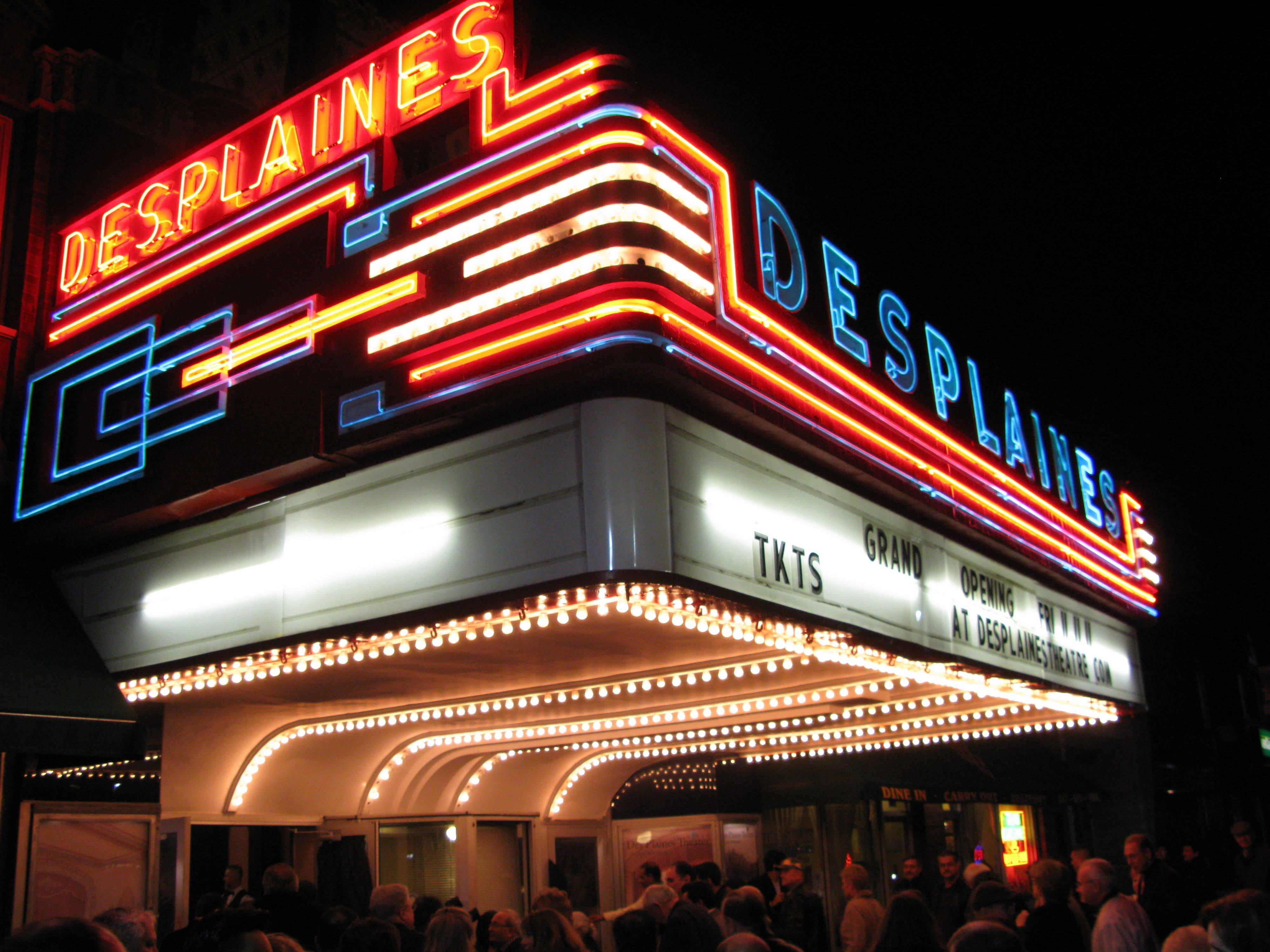 More than 300 people witnessed the marquee lights of the Des Plaines Theatre go on for the first time in two years Friday.
