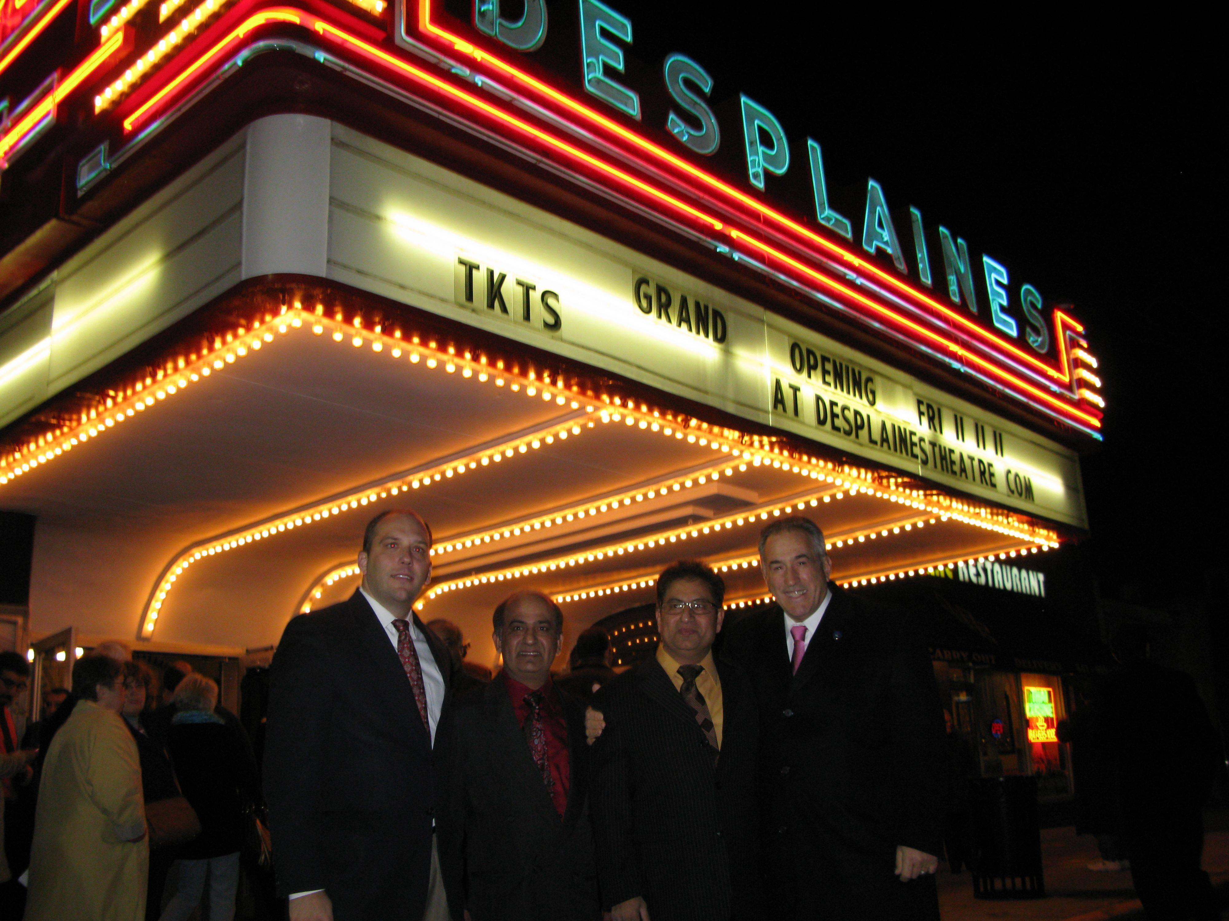 Des Plaines Acting City Manager Jason Slowinski, Des Plaines Theatre owners, brothers Dharmesh and Dhitu Bhagwakar, and Mayor Marty Moylan at the theater's grand reopening Friday.