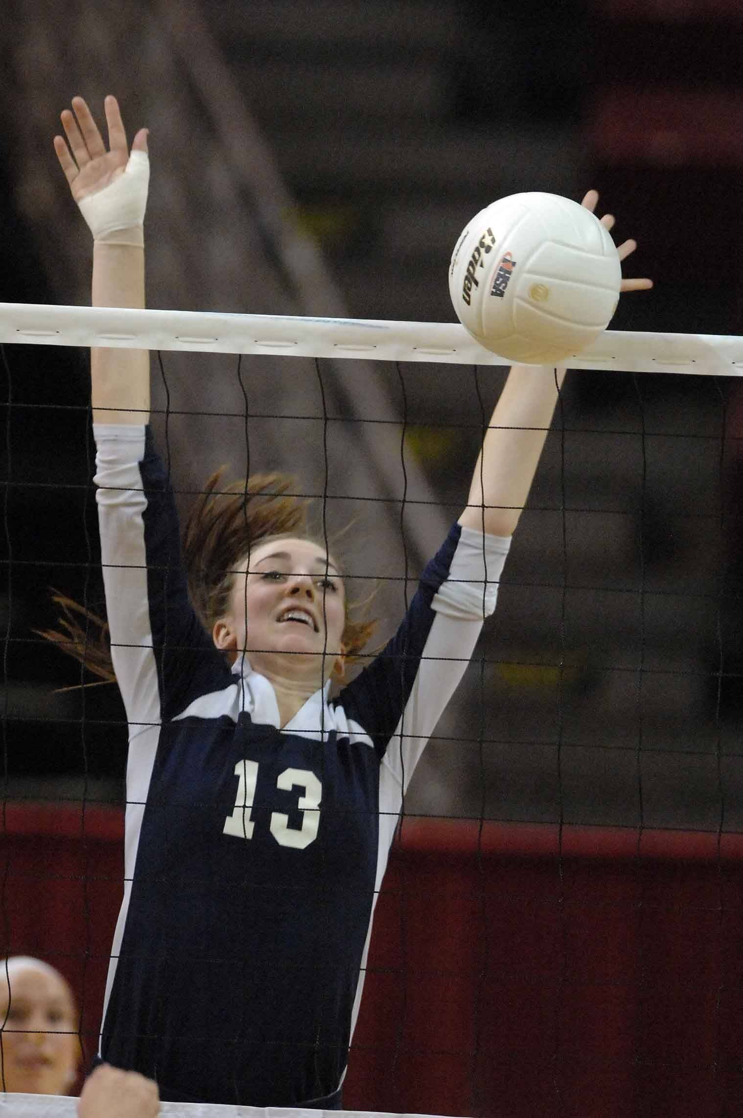 Sheila Wilhelmi of Cary goes up for a block during the Benet vs. Cary Class 4A volleyball championship in Normal Saturday.