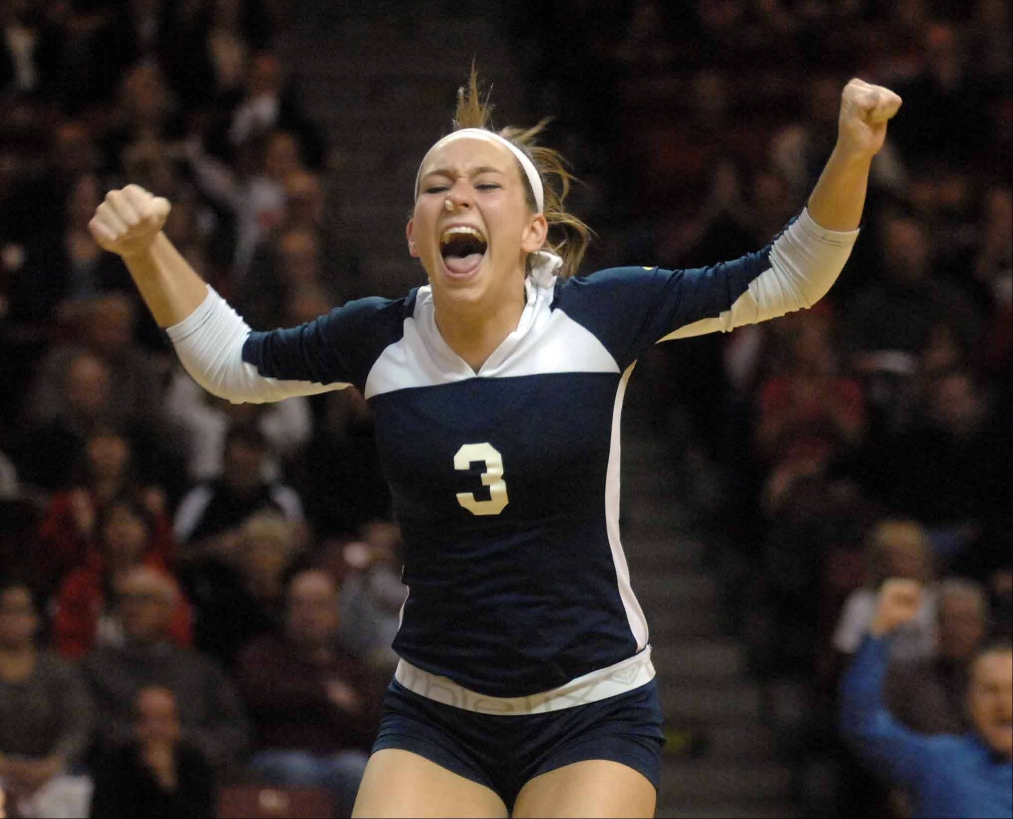 Korey Kronforst of Cary-Grove gets excited during the Benet vs. Cary Class 4A volleyball championship in Normal Saturday.