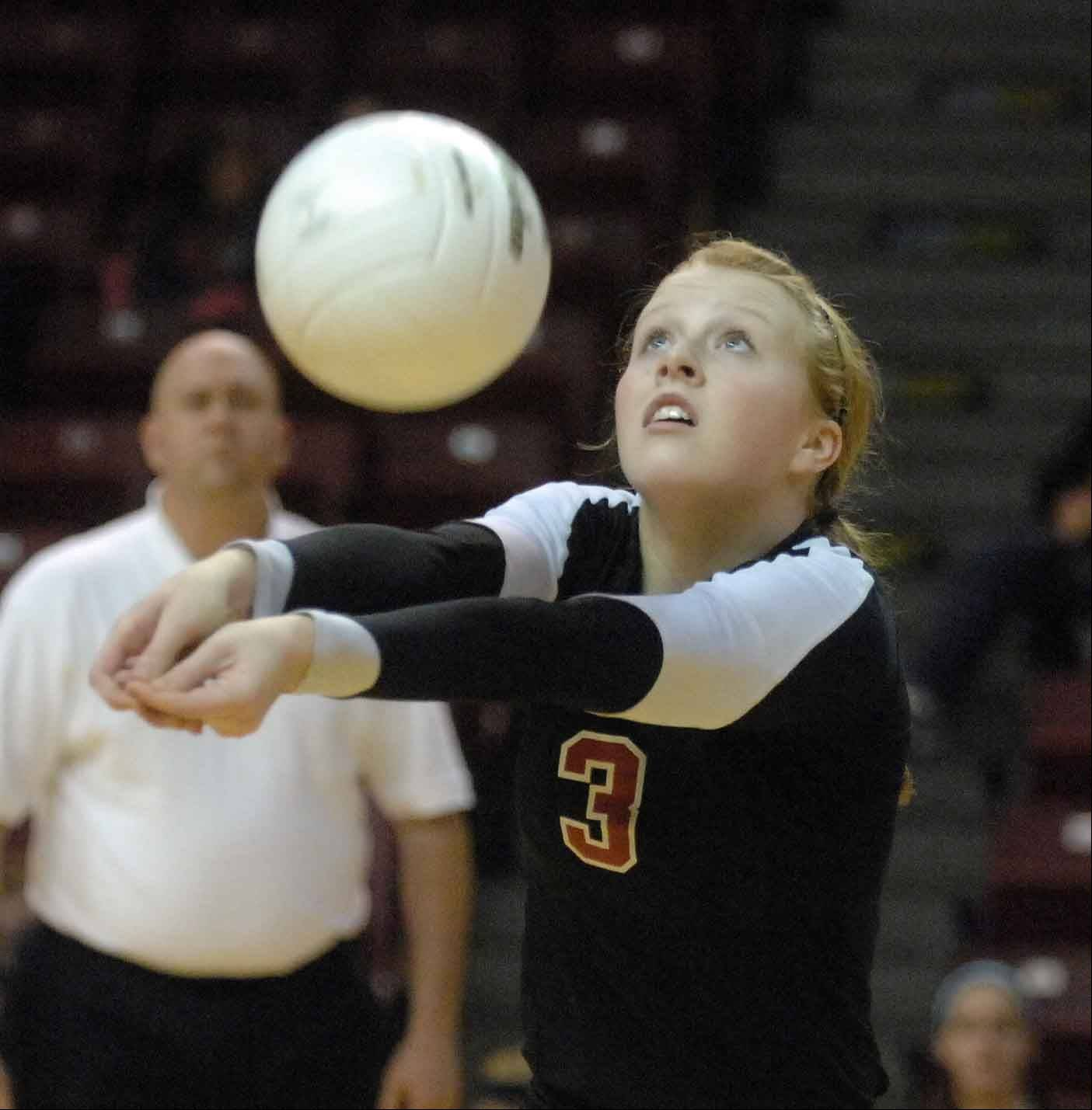 Shelia Doyle of Benet bumps one during the Benet vs. Cary Class 4A volleyball championship in Normal Saturday.