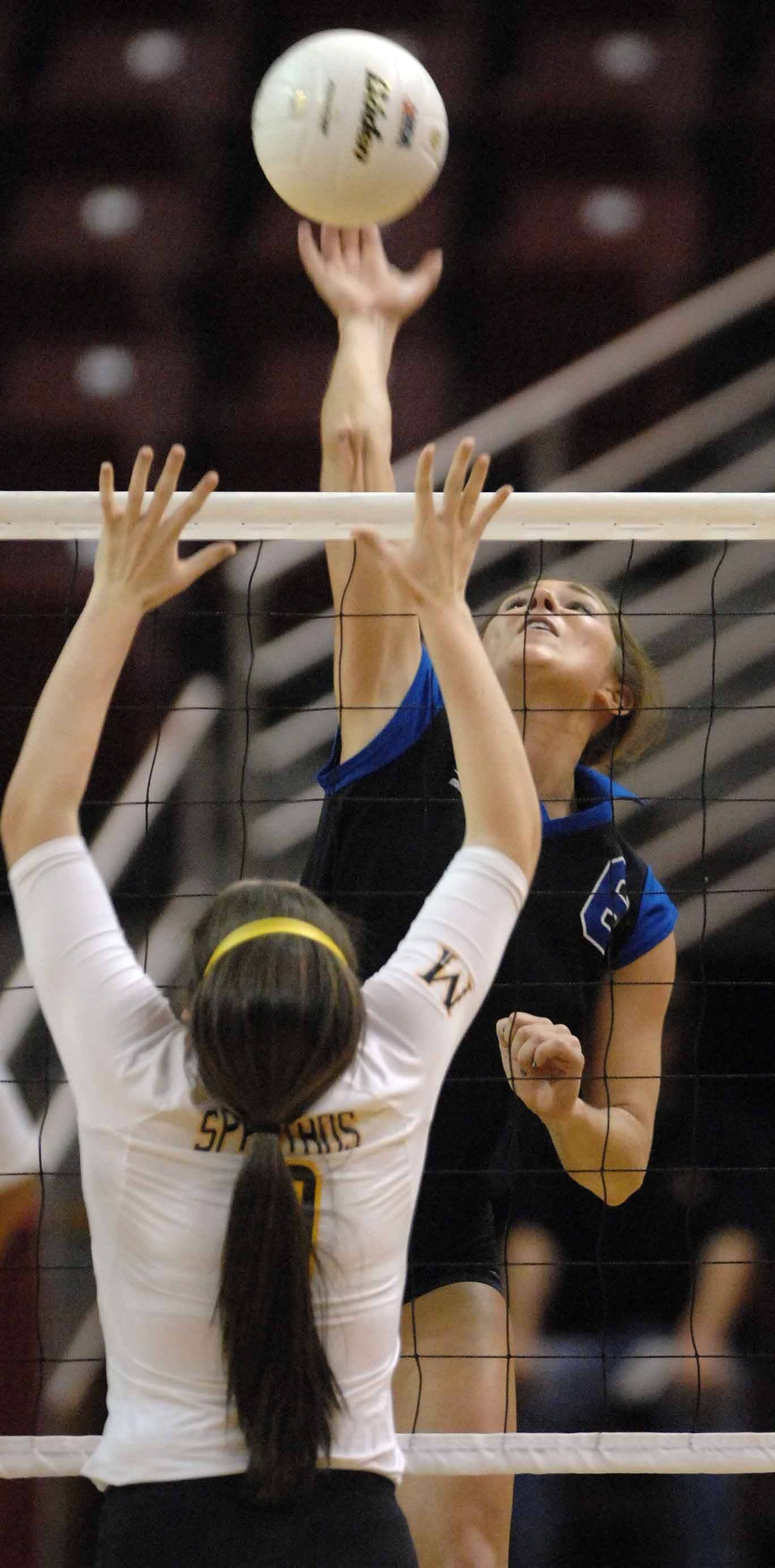 Grace Churney of St. Francis taps one during the St. Francis vs. Marian in the 3A third-place match Saturday.