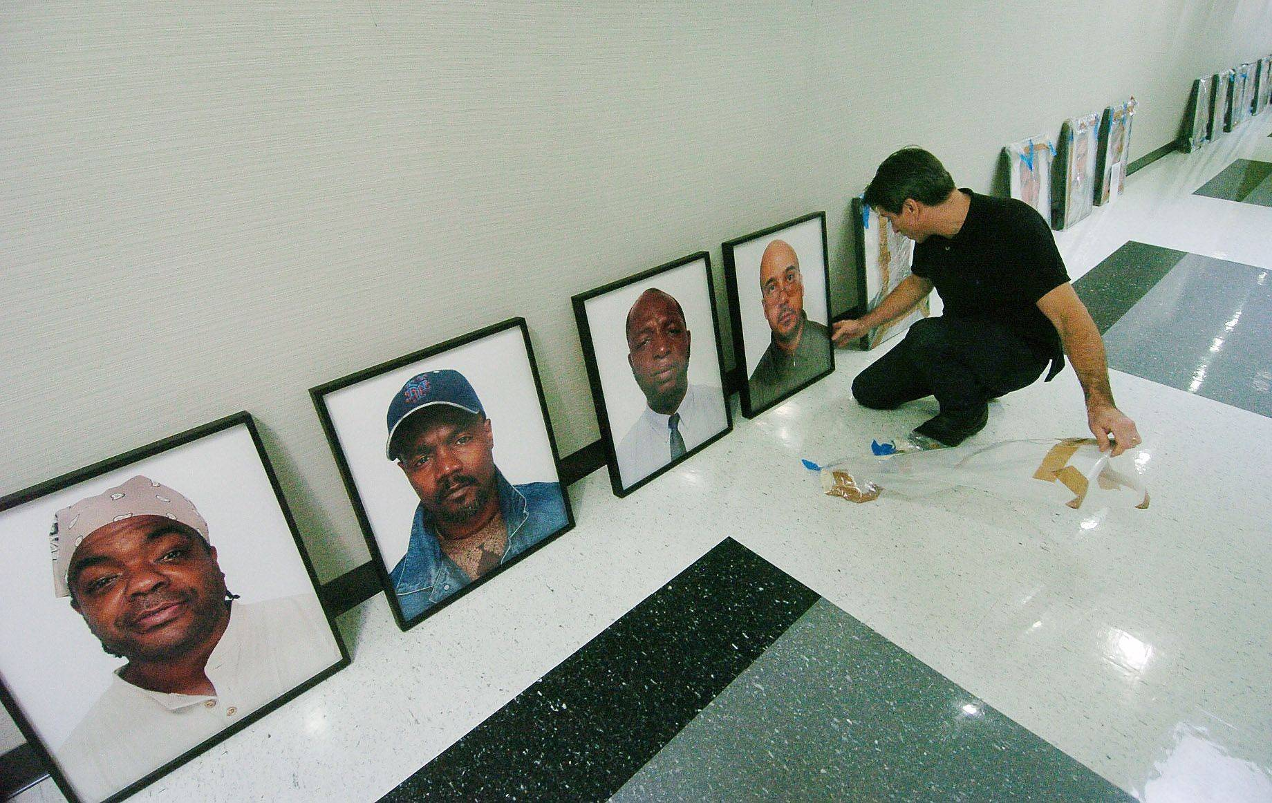 "Mike Ensdorf, professor of communications at Roosevelt University, prepares an exhibit of photos of wrongfully convicted Americans called ""The Innocents: Headshots,"" that will be on display beginning today through January 13 at the college's Schaumburg campus."