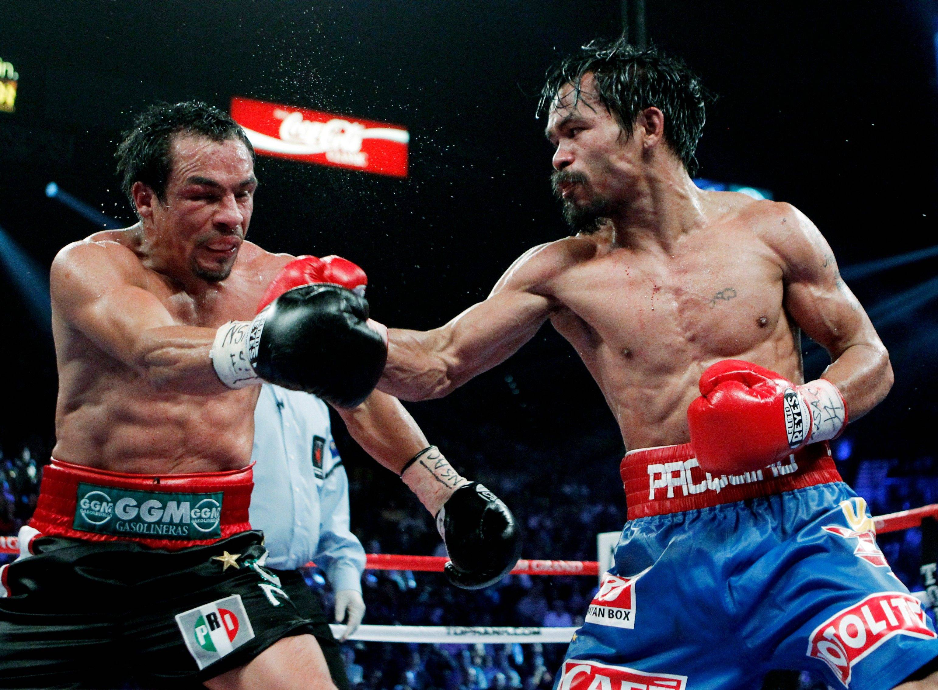 Manny Pacquiao, right, hits Mexico's Juan Manuel Marquez Saturday during a WBO welterweight title fight.