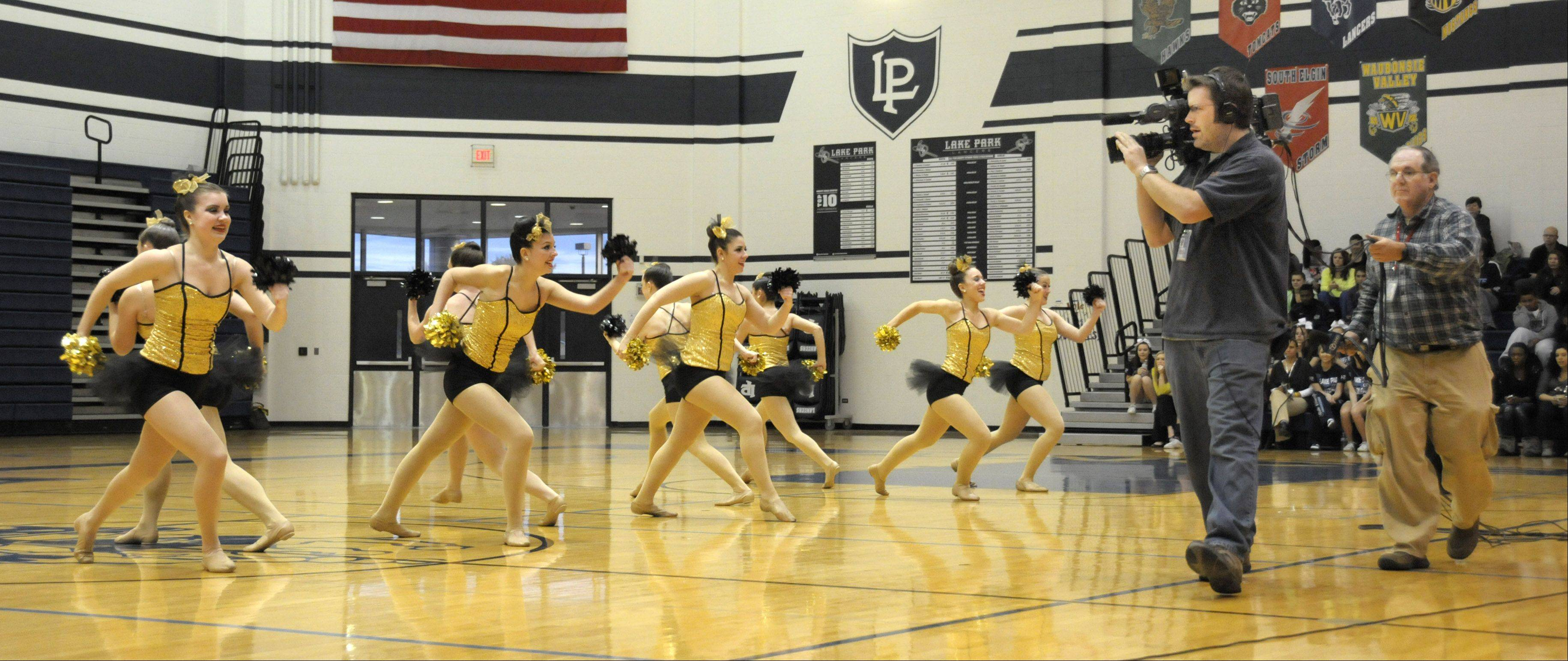 "Lake Park High School's Lancettes dance team performs live Monday on ABC 7's morning news show. The team is competing against other suburban dance squads in the ""Dance Team Dance-off."" Viewers can vote Thursday and the winning team will be announced Friday."