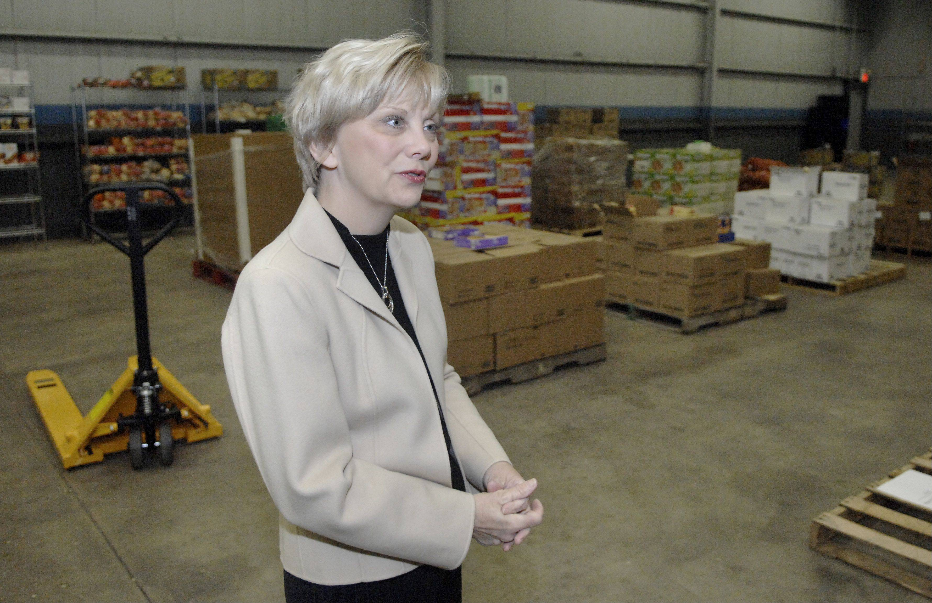 Feeding Greater Elgin Executive Director Susan Ericson in the new office and warehouse in Elgin.
