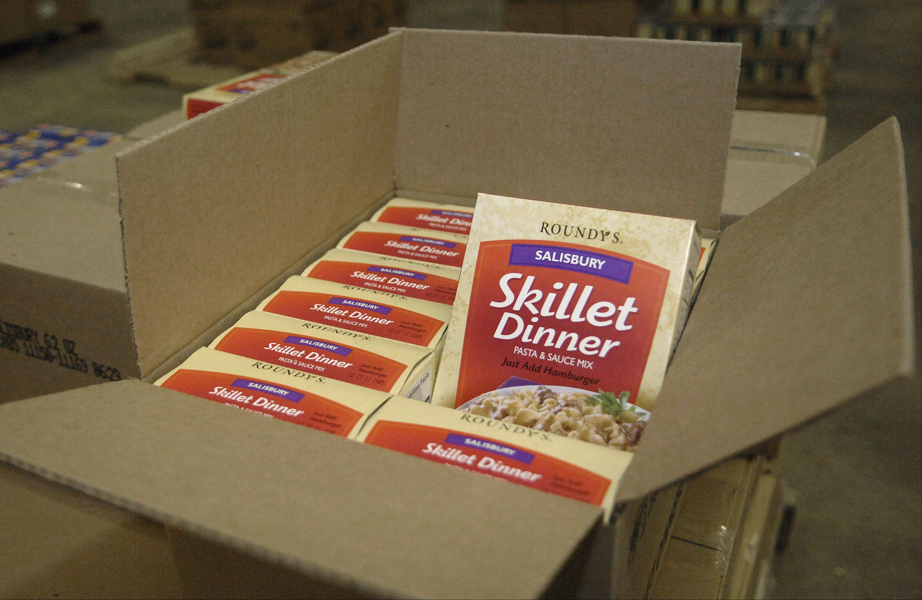 Boxes of food sit neatly displayed in the new warehouse of Feeding Greater Elgin, a nonprofit dedicated to addressing hunger in Elgin and South Elgin, where more than 11,000 people live in poverty.