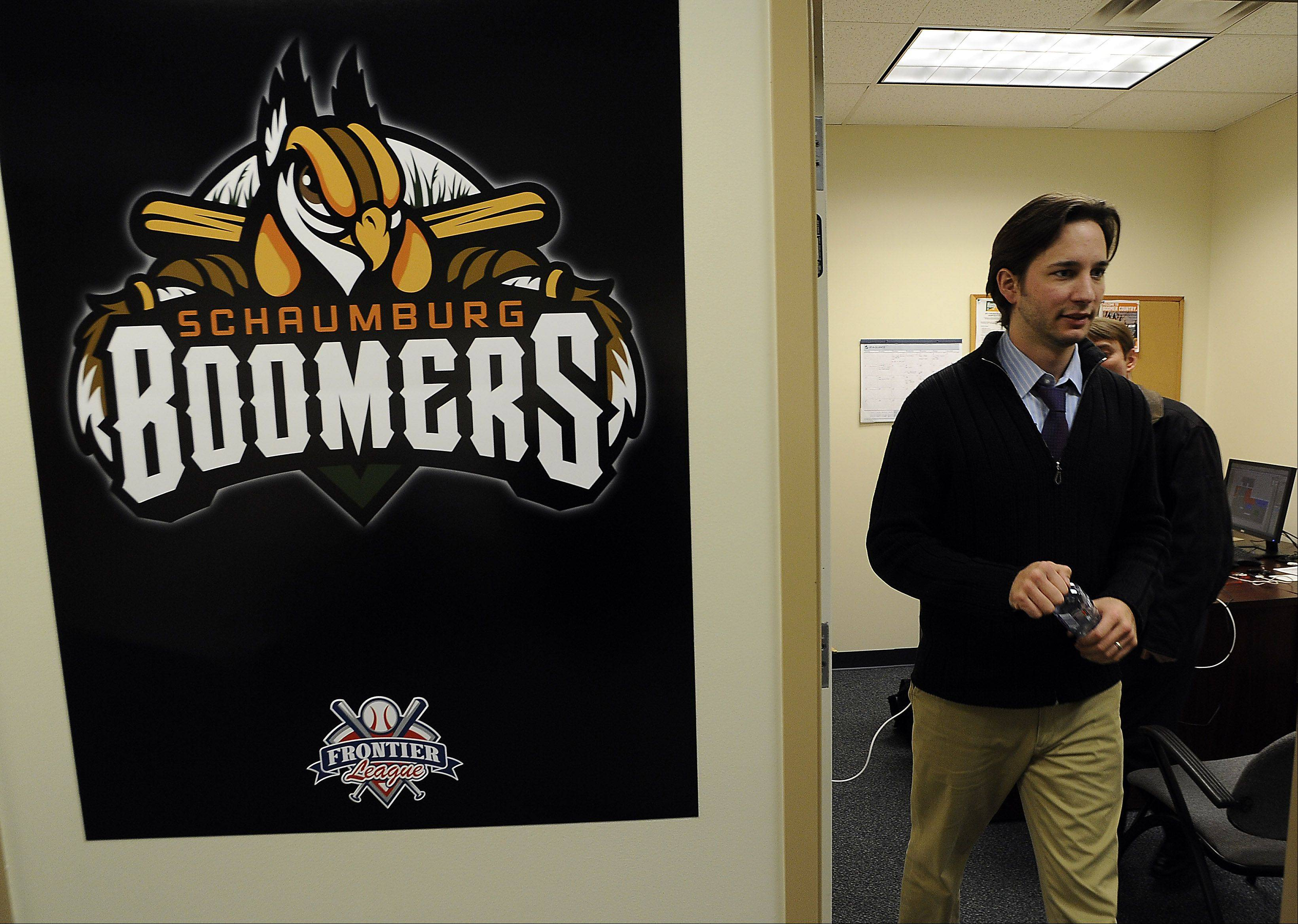 Dave Salvi, vice president of marketing and promotions for the Schaumbutg Boomers baseball team, leaves his office to check out the new turf grass on the field.