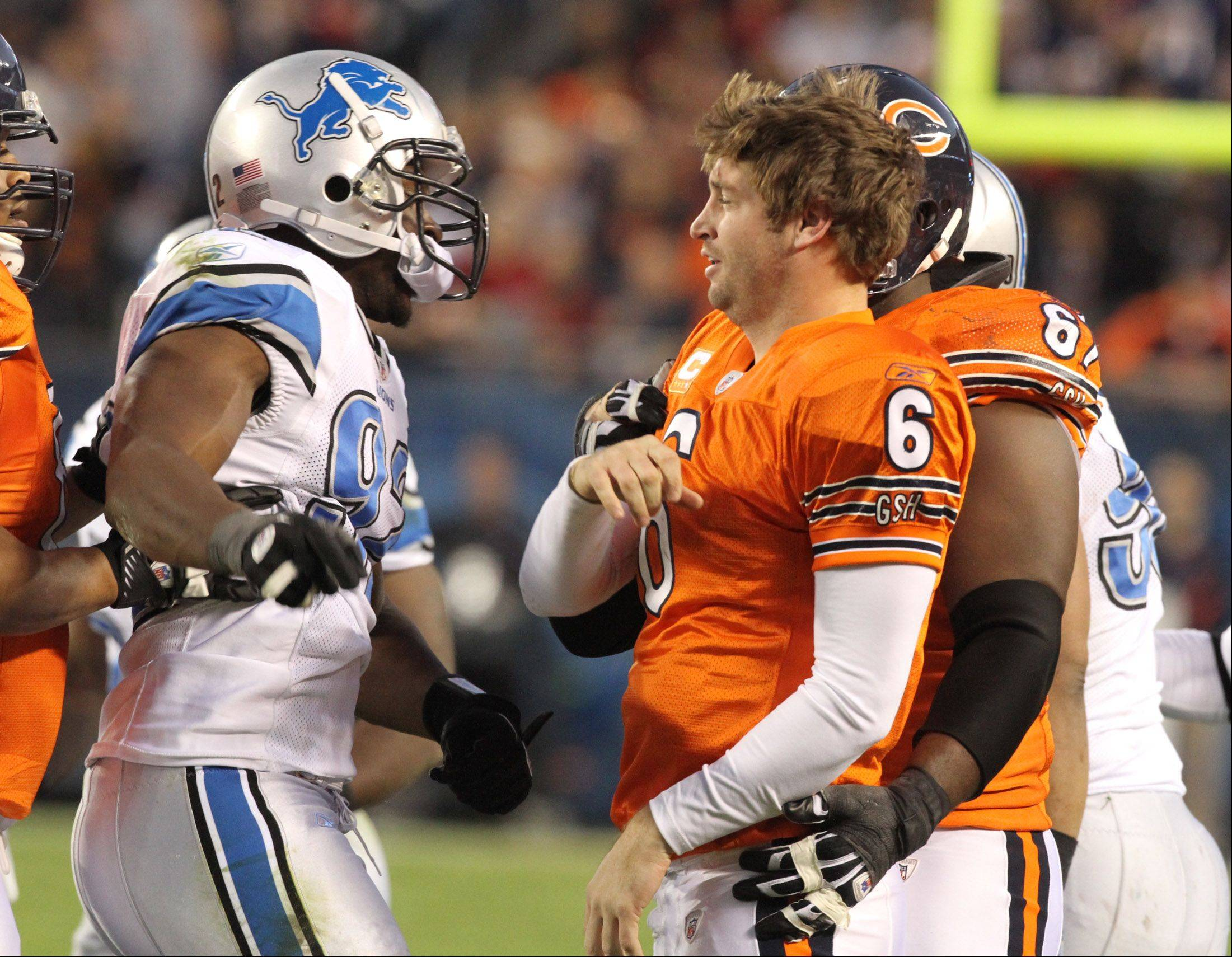 Chicago Bears Jay Cutler after being sacked by Detroit Lions Cliff Avril at Soldier Field on Sunday.