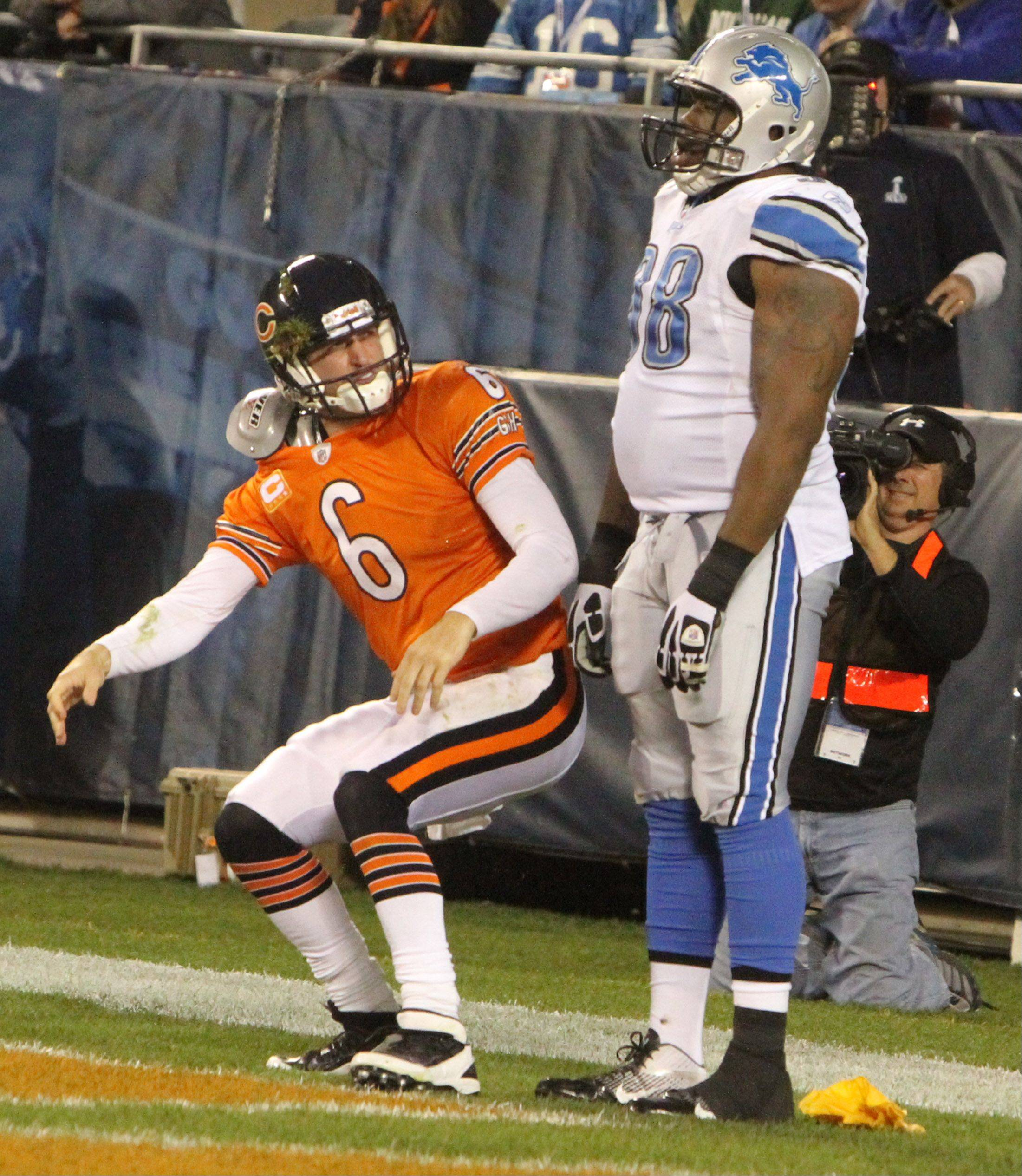 Bears quarterback Jay Cutler reacts to suffering some unnecessary roughness from Lions defender Nick Fairley in the fourth quarter Sunday.