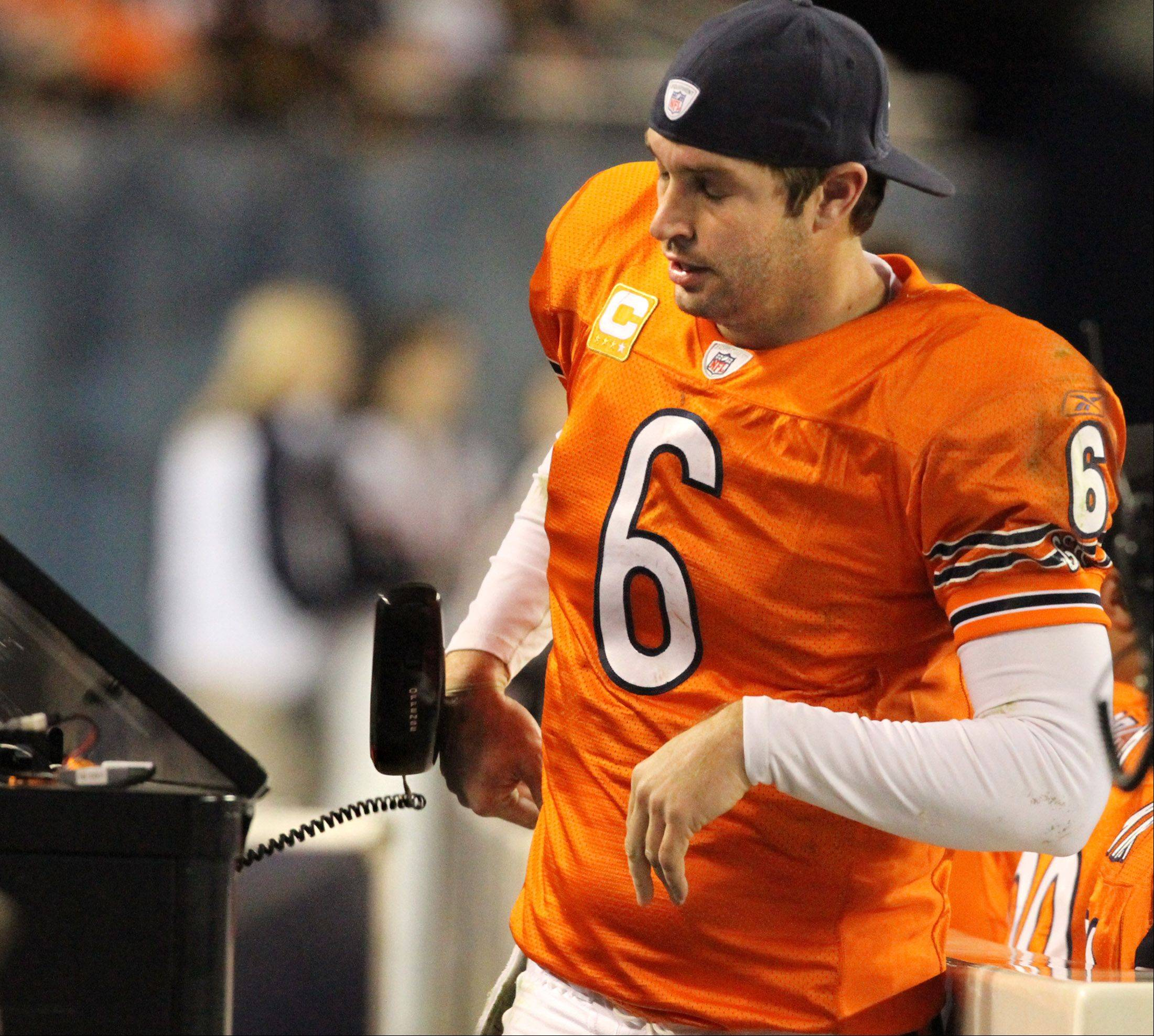Chicago Bears quarterback Jay Cutler slams the sideline phone down after speaking to someone in the coaches booth after Cutler was sacked in the fourth-quarter against Detroit Lions at Soldier Field on Sunday.