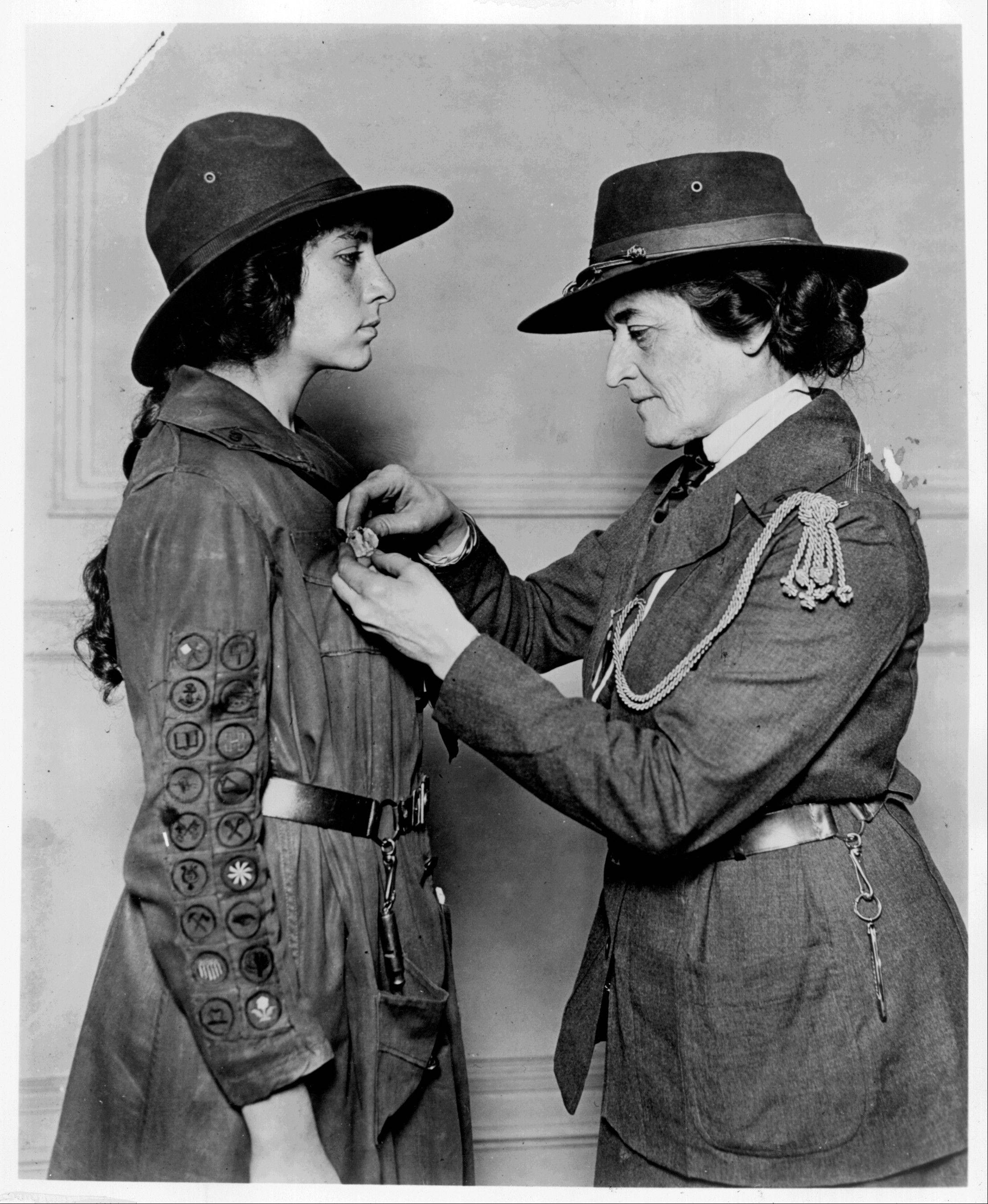Girl Scouts founder Juliette Gordon Low awards the Golden Eaglet to a Girl Scout in 1919. Low began the organization in March 1912 to encourage girls to explore their world.