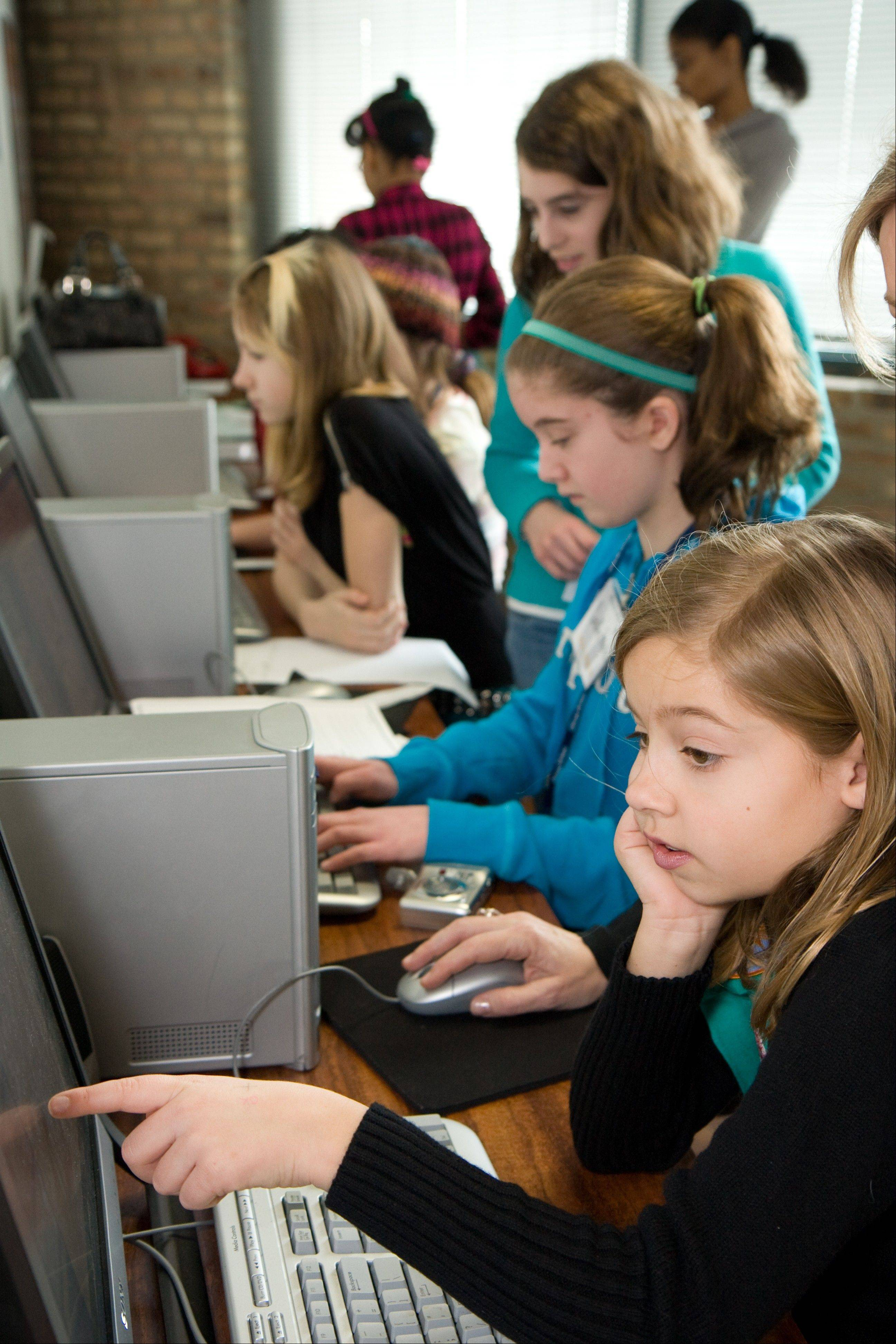 Girl Scouts gather at Journey World, an interactive Girl Scout learning center in Chicago, where girls of all ages who live in the council area can learn about science, technology, engineering, math, business and environmental sciences.
