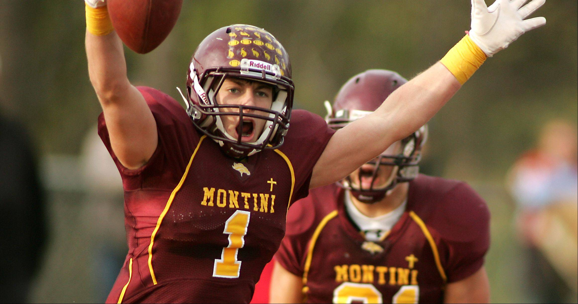 Joe Borsellino, 1, celebrates his touchdown catch during Montini's 52-27 win over Marian Central.