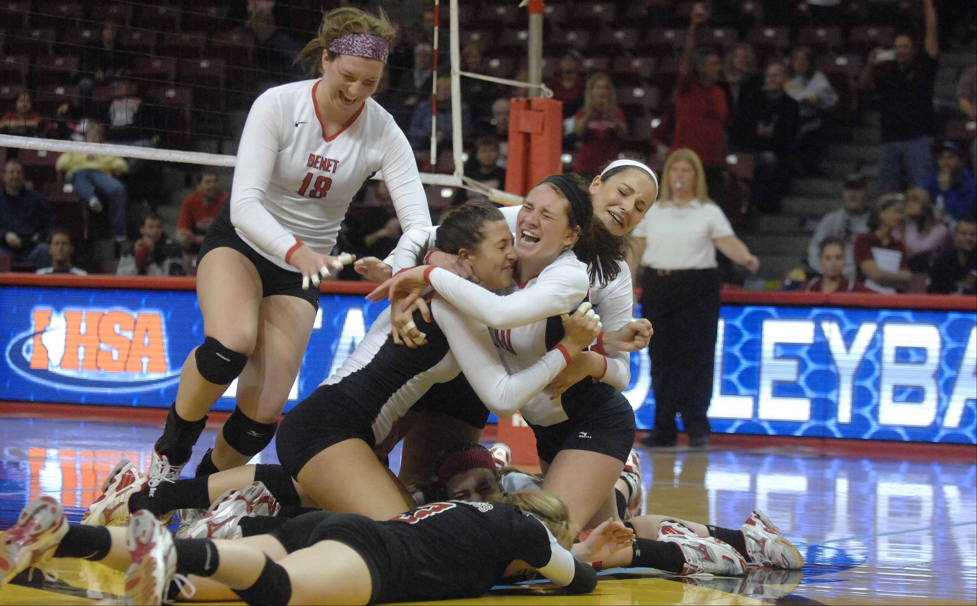 Benet players celebrate their Class 4A volleyball championship win over Cary-Grove Saturday in Normal.