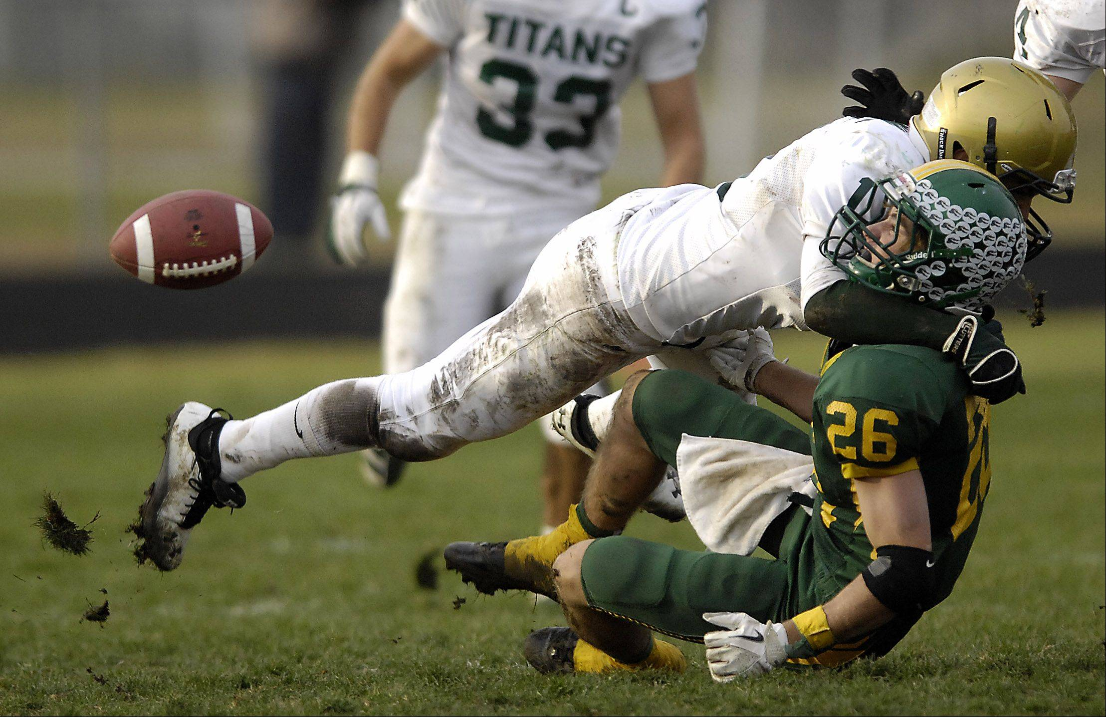 Boylan Catholic's Peter Cimino tackles Crystal Lake South's Brandon LaPak during their quarterfinal game Saturday in Crystal Lake. Boylan Catholic won the game, ending Crystal Lake's season.