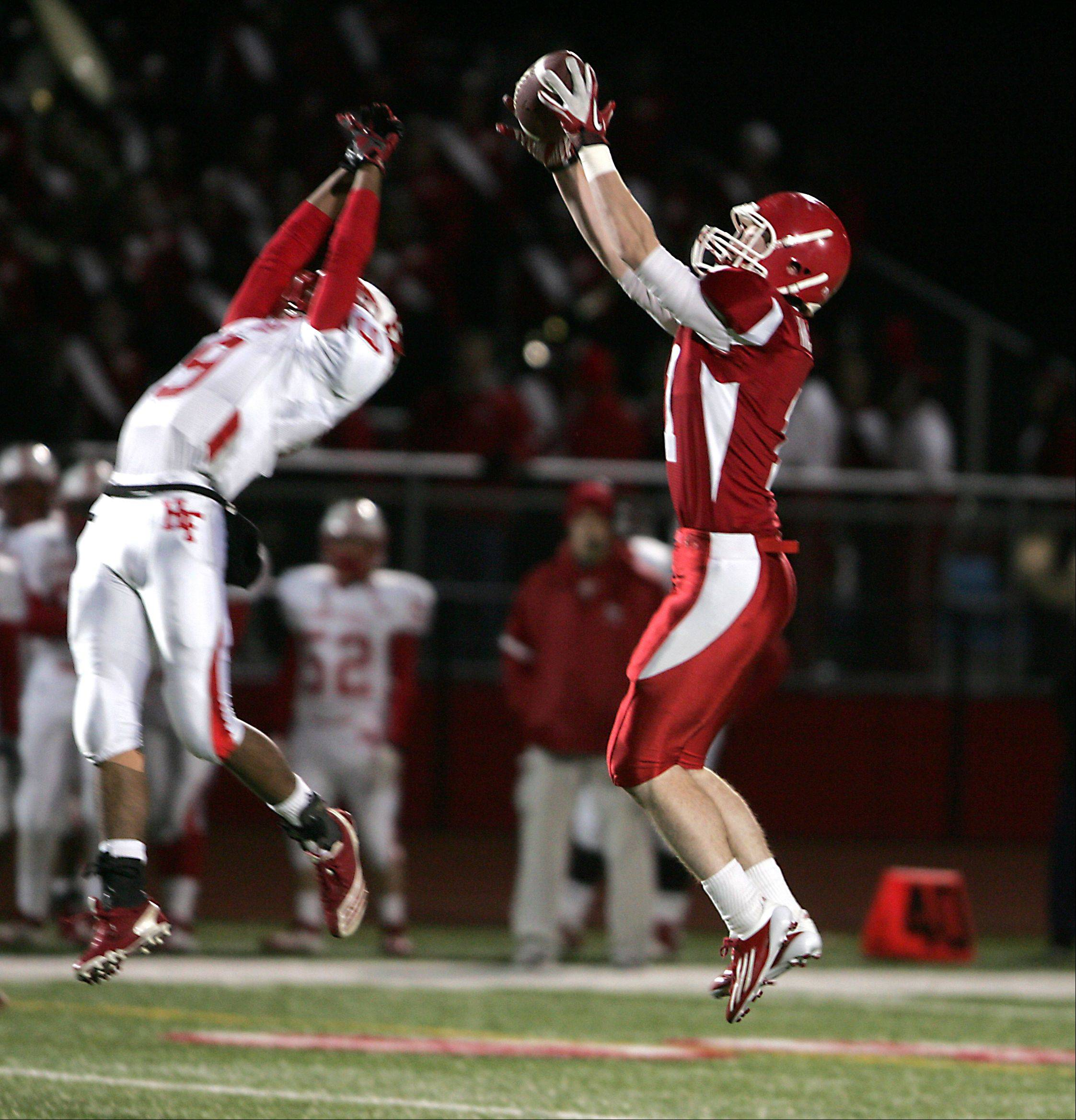 Naperville Central's Jimmy Nashert, right, intercepts a Homewood-Flossmoor pass during Friday's Class 8A quarterfinal action in Naperville.