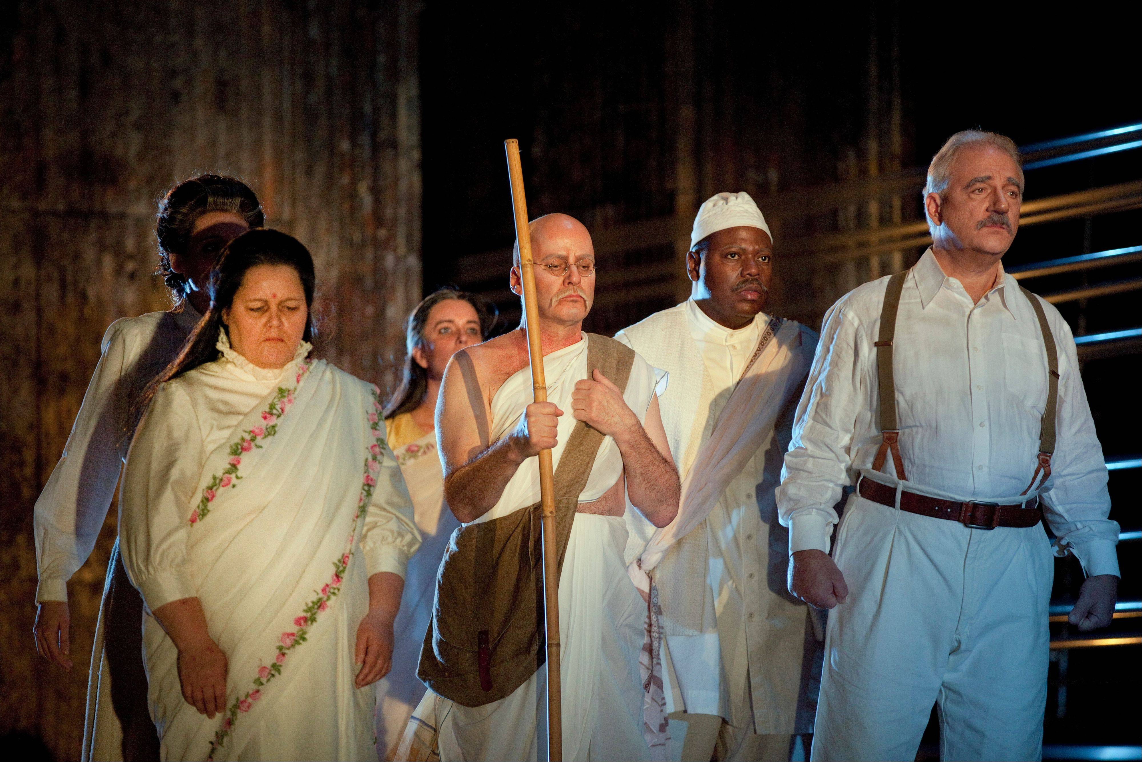 "Tenor Richard Croft, center, portrays Gandhi in Philip Glass' opera ""Satyagraha,"" which will be shown worldwide in movie theaters as part of the Metropolitan Opera's Live in HD series."