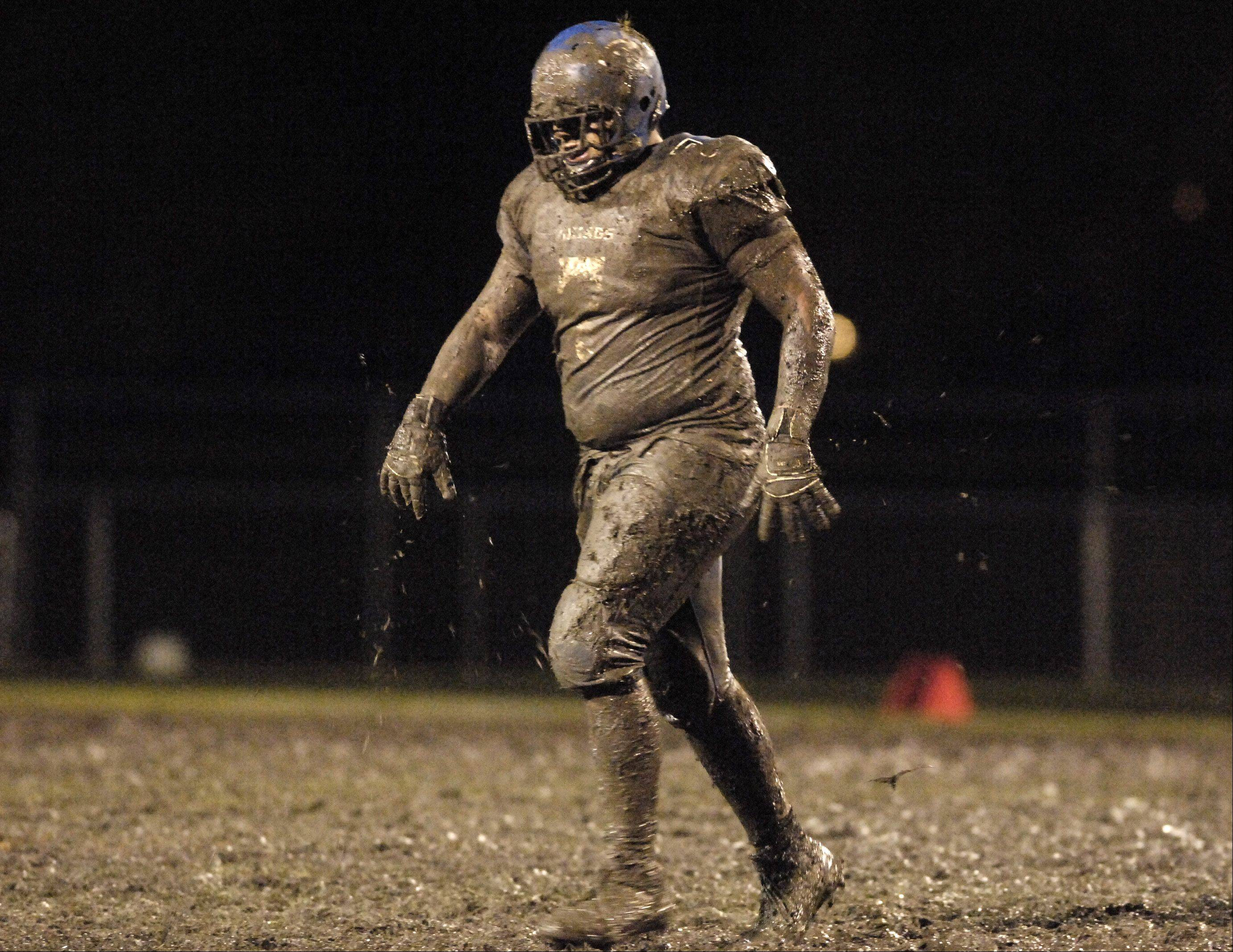 A Geneva Viking shakes mud off as he comes off Burgess Field during a game in 2009. Sights like this will likely become a thing of the past, as the Geneva school district advances plans to replace the field with artificial turf.