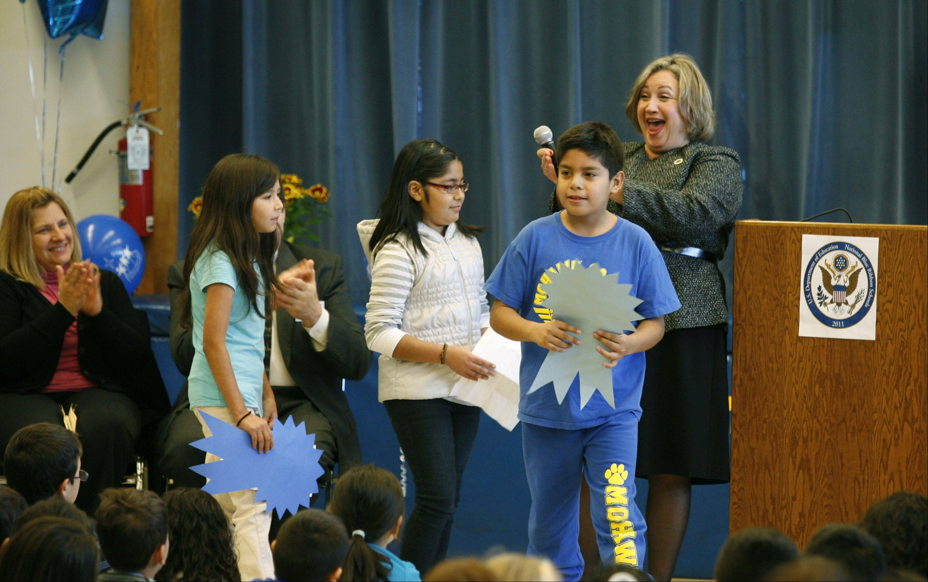 Mohawk Elementary School students join Principal Madelyn Devers during a ceremony Wednesday recognizing the school's 2011 National Blue Ribbon School Award from the U.S. Department of Education.