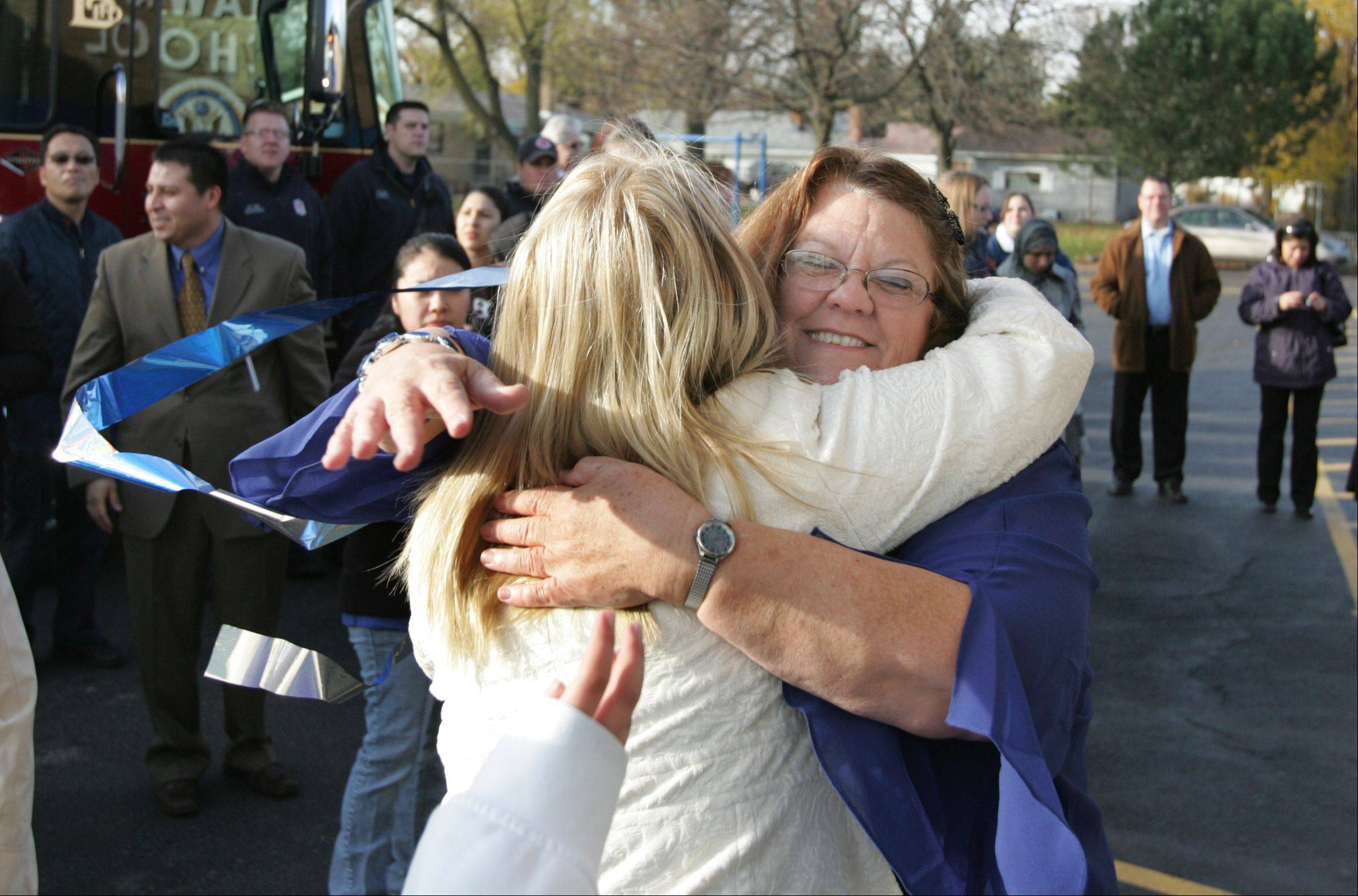 Mohawk Elementary School teacher Jean Walsh, right, arrived at the school Wednesday in a police and fire procession after a two-day trip to Washington, D.C., to receive the 2011 National Blue Ribbon Award from the U.S. Department of Education.