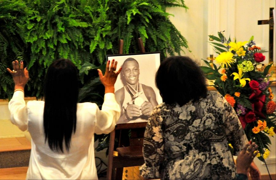 Joe Frazier's daughter Jacqui Frazier Lyde, left, and niece Dannette Frazier, right, celebrate his life with family and friends Wednesday at a memorial service for the former heavyweight boxing champion at the Bethesda Christian Fellowship Temple in St. Helena Island, S.C. Frazier died earlier this month from liver cancer. He was 67.