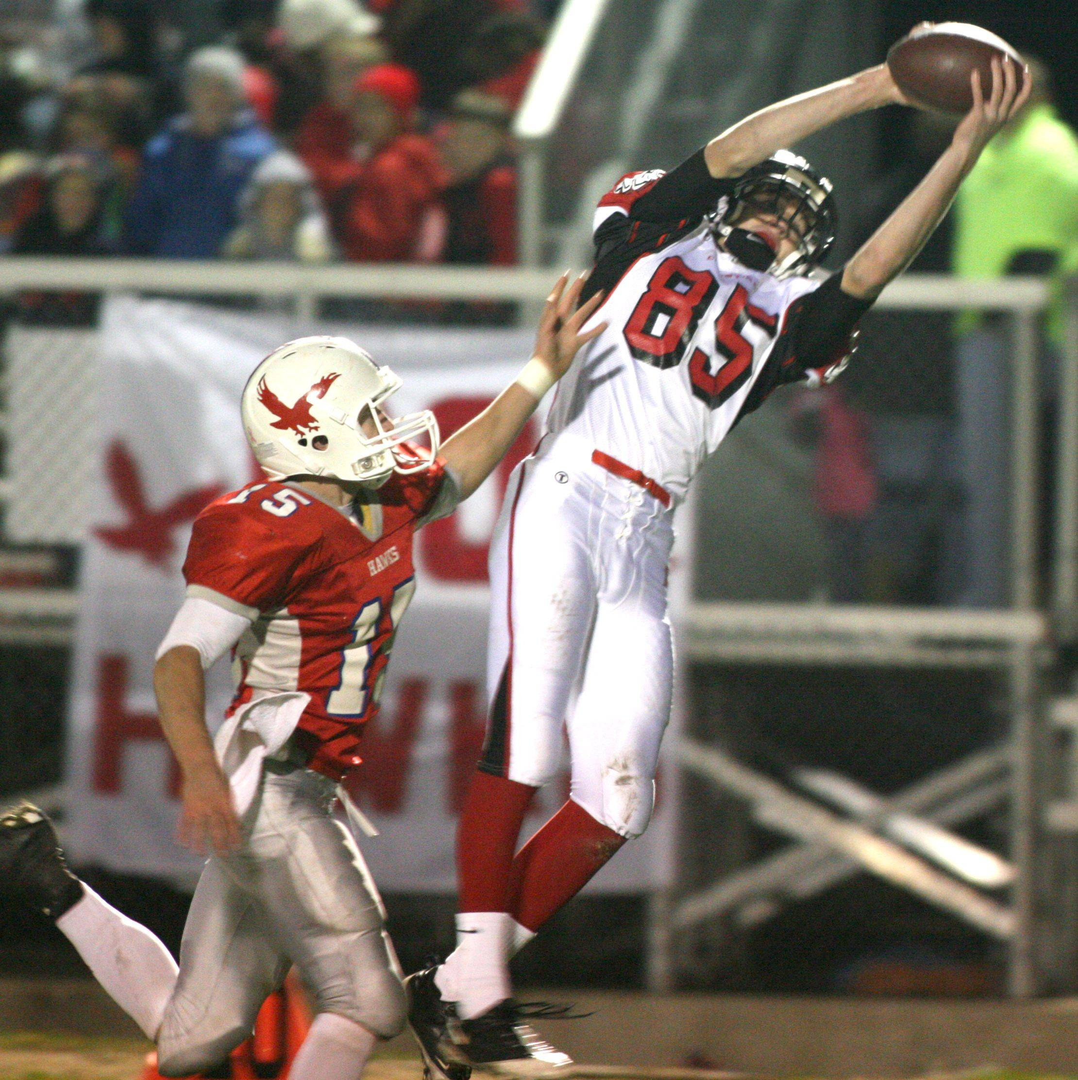 Aurora Christian's Cory Windle hauls in a pass in front of Oregon's Josh Egyed at Oregon during a playoff game two weeks ago. The Eagles host Tolono Unity in a Class 3A semifinal Saturday.