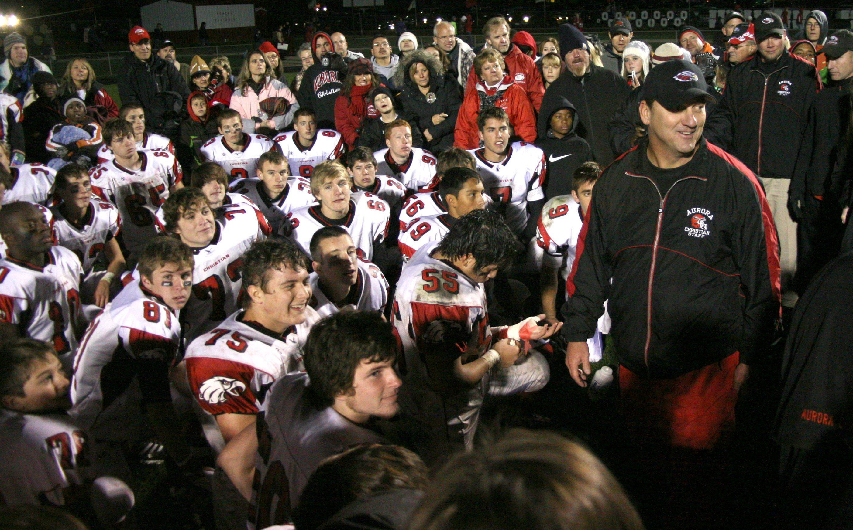 Aurora Christian head coach Don Beebe addresses his team Nov. 4 after a playoff victory at Oregon.