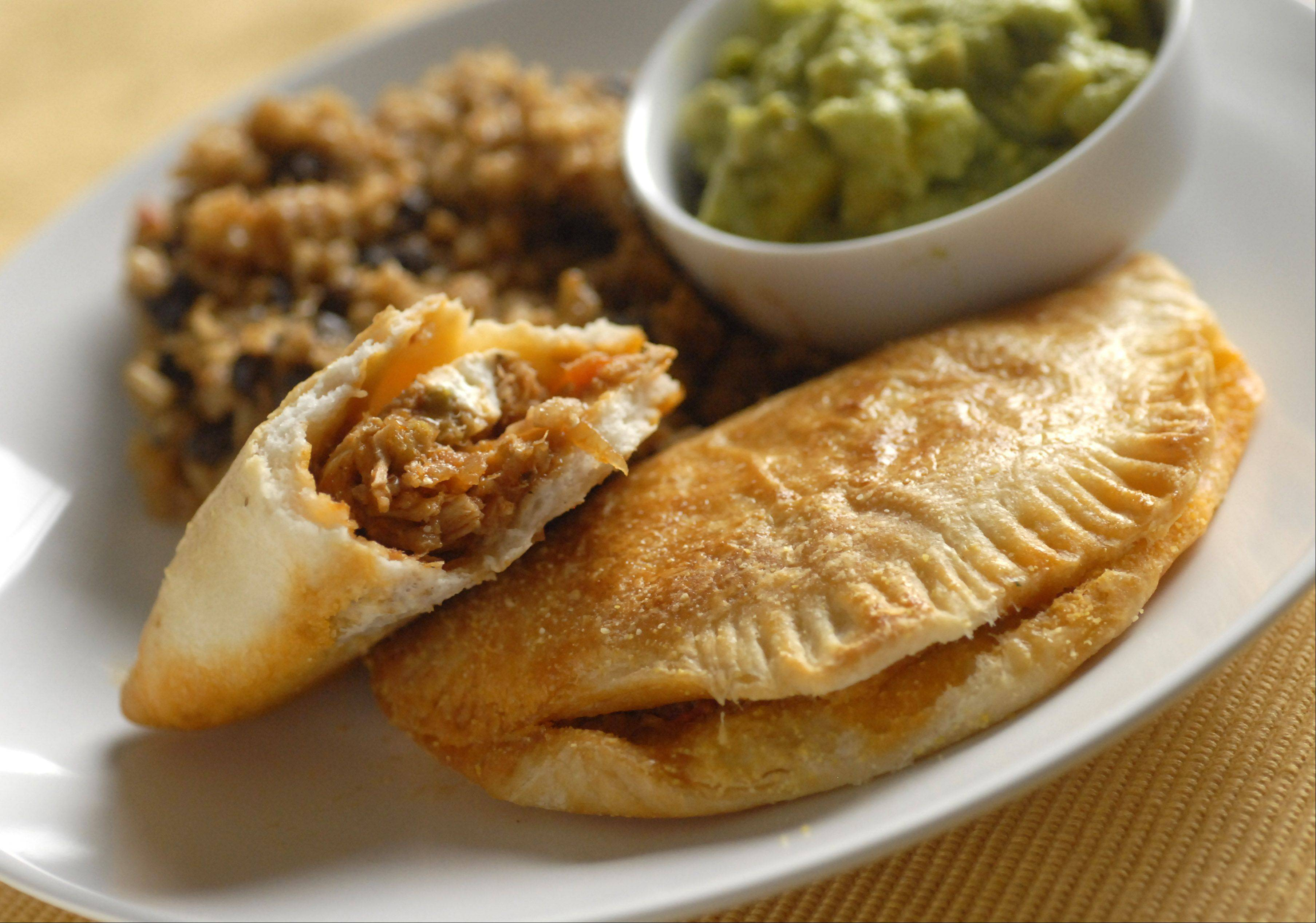 Saucy Tuna Empanadas with Cuban Black Beans and Mango Guacamole