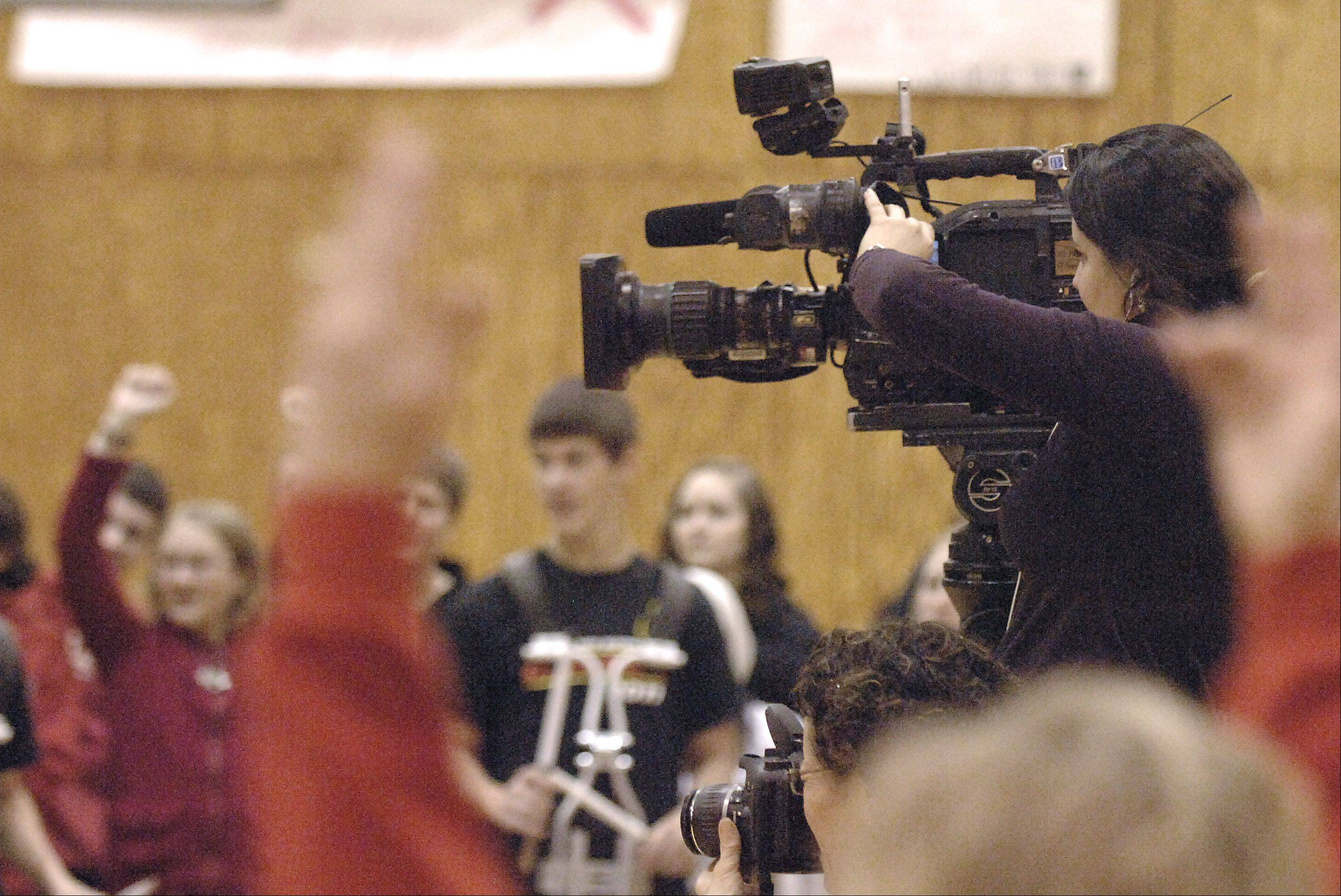 "NBC5 camerawoman Maria Ruiz tapes a live shot of Batavia High School students during the newscast's ""Prep Destination of the Week"" Friday."