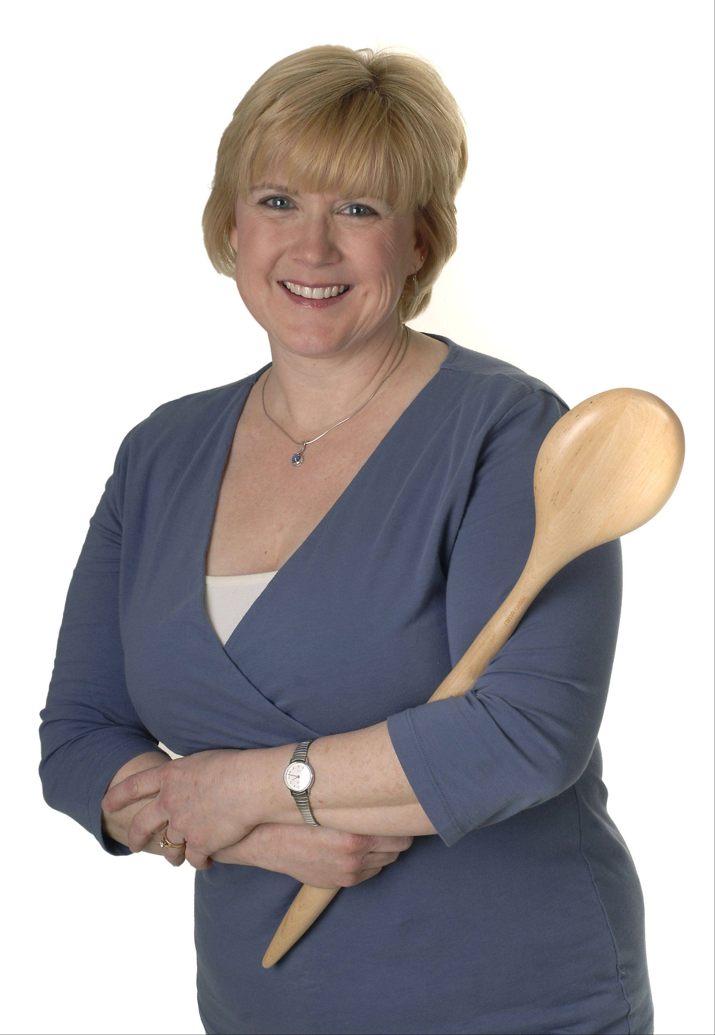 Daily Herald Food Editor Deborah Pankey, shown with a wooden spoon signed by celebrity chef Mario Batali, was a driving force behind the inaugural Cook of the Week Challenge.