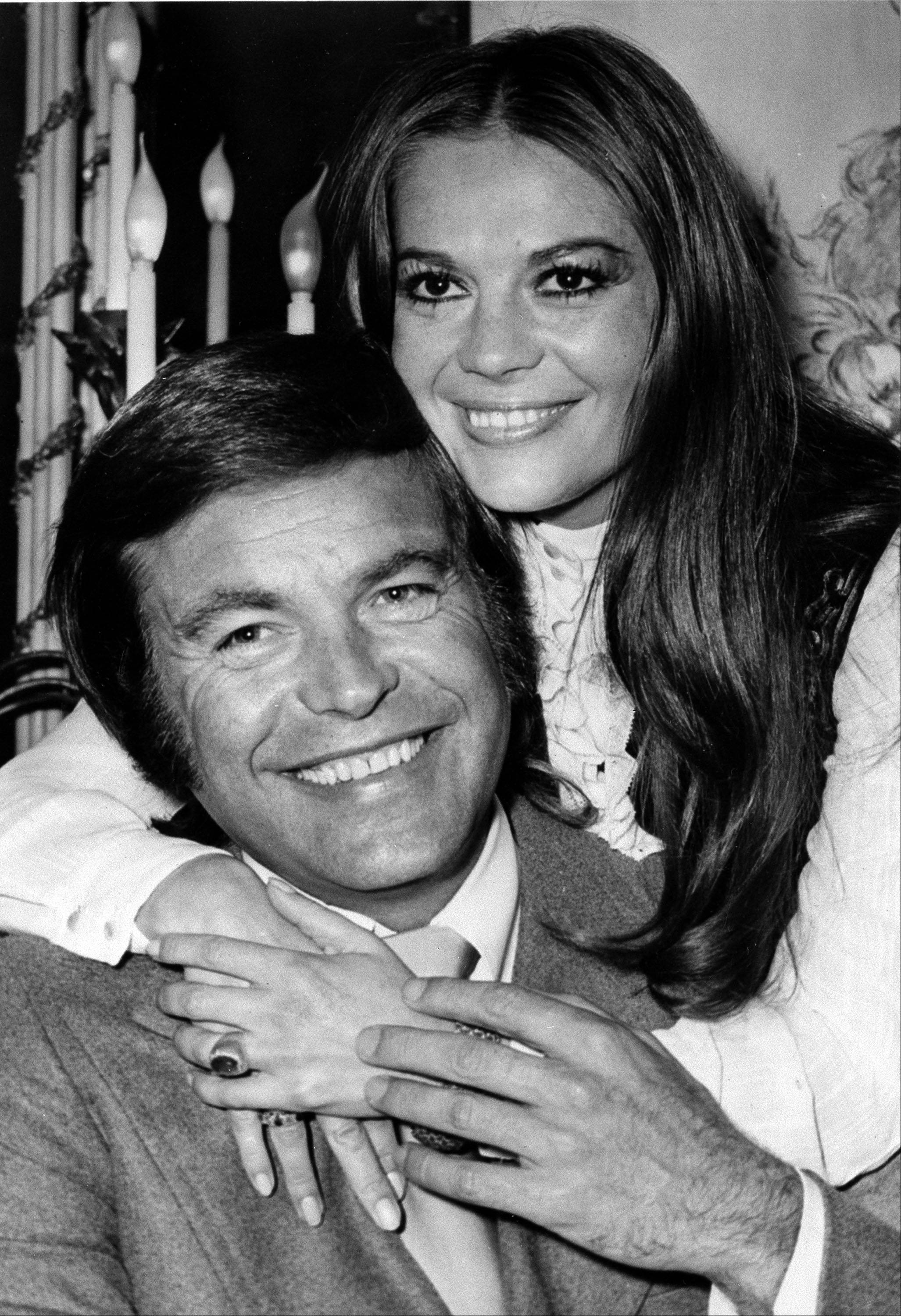 In this April 23, 1972 file photo, actor Robert Wagner and actress Natalie Wood pose at the Dorchester Hotel in London. Los Angeles sheriff's homicide detectives are taking another look at Wood's 1981 drowning death based on new information, officials announced Thursday, Nov. 17, 2011. A yacht captain said on national TV Friday, Nov. 18, 2011, that he lied to investigators about Natalie Wood's mysterious death 30 years ago and blames Wagner for her drowning in the ocean off Southern California. (AP Photo, File)
