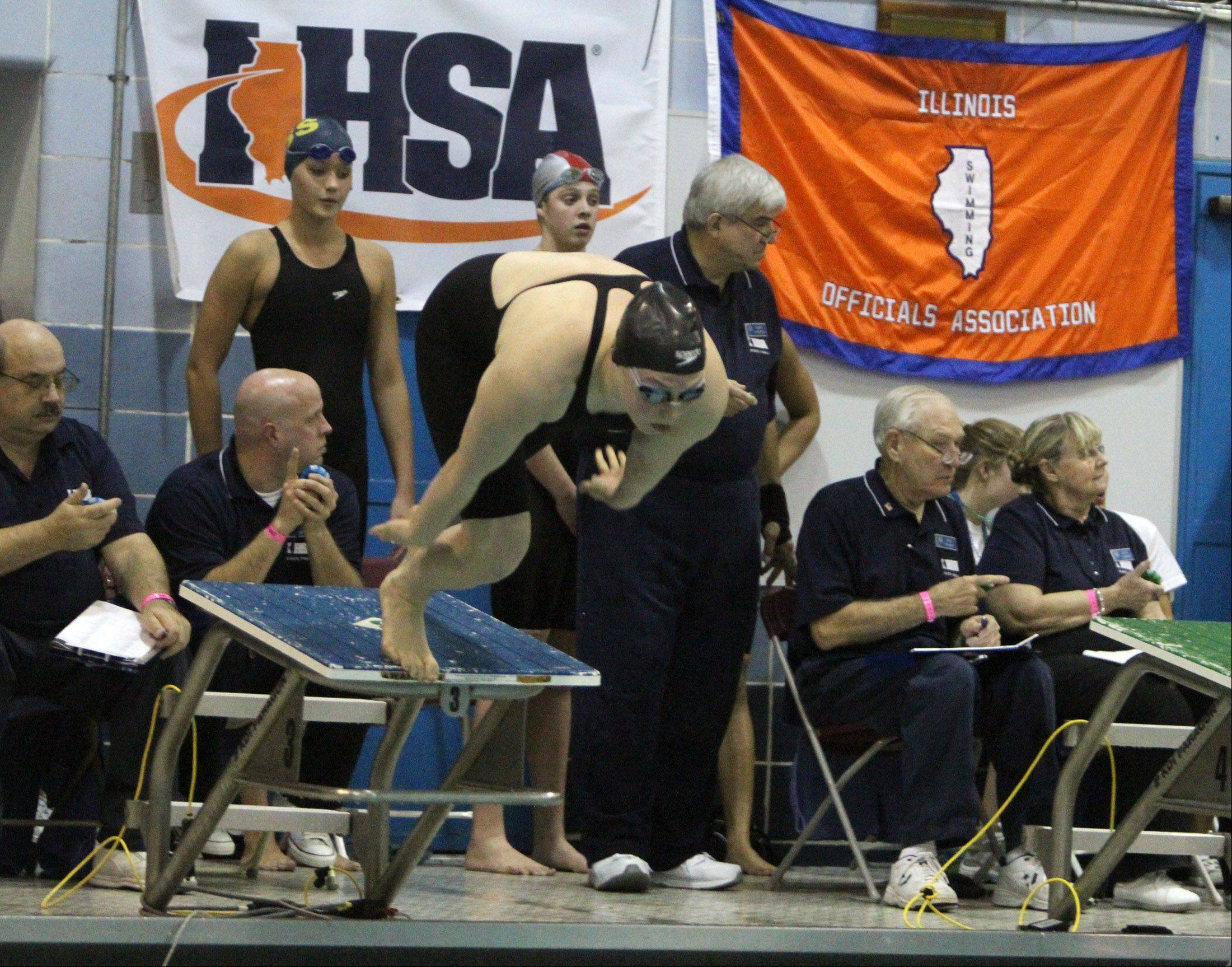 Barrington's Erika Elliott at the start of the 50-yard freestyle at IHSA state final preliminaries in Winnetka on Friday, November 18th.