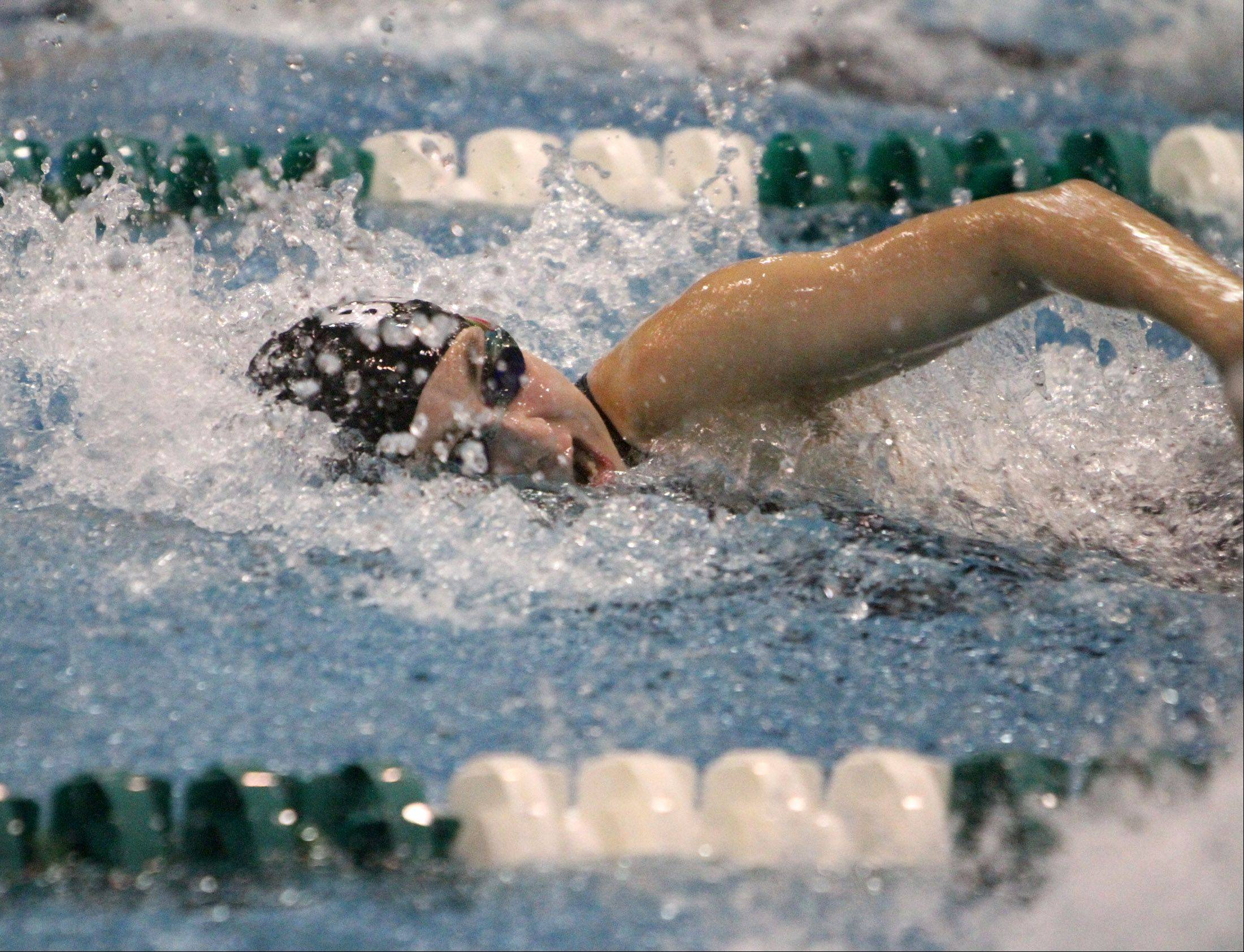 Rosary's Katherine Hare competes in the 100-yard freestyle in Winnetka on Friday.