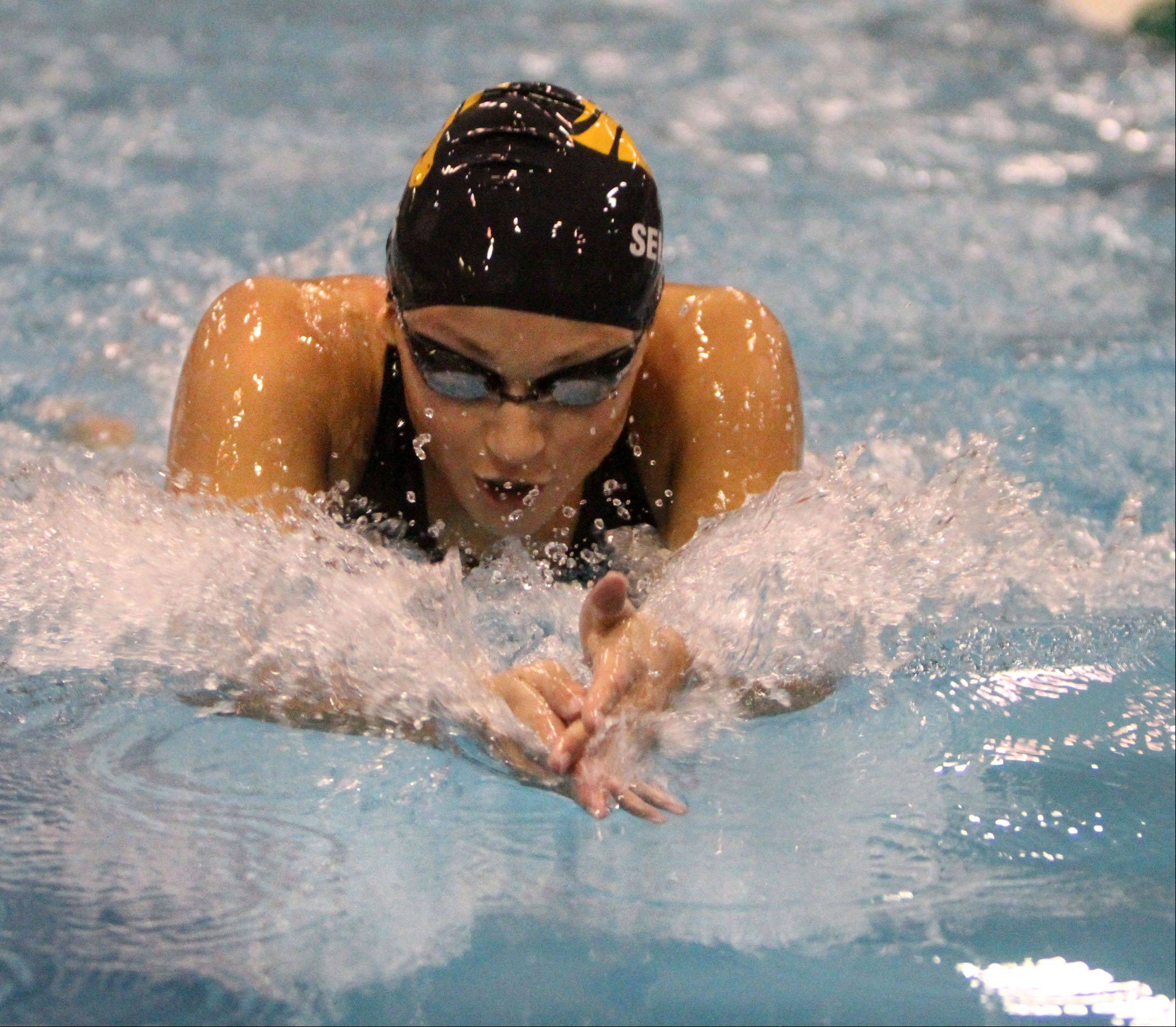 Metea Valley's Megan Sellers competes in the 100-yard breaststroke at the IHSA state final preliminaries in Winnetka on Friday, November 18th.