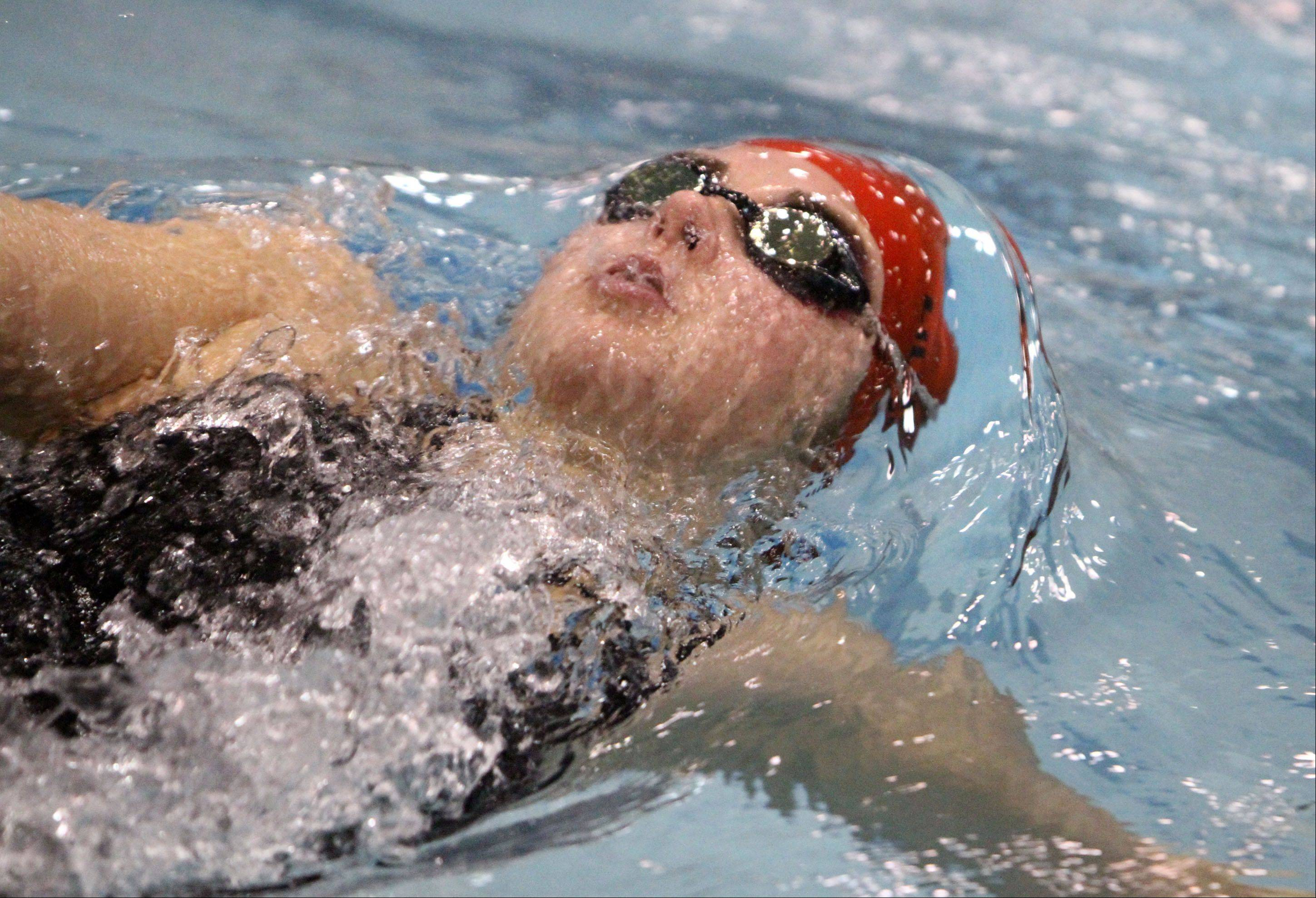 Hinsdale Central's Hannah Lillioja competes in the 100-yard backstroke at the state final preliminaries Friday.